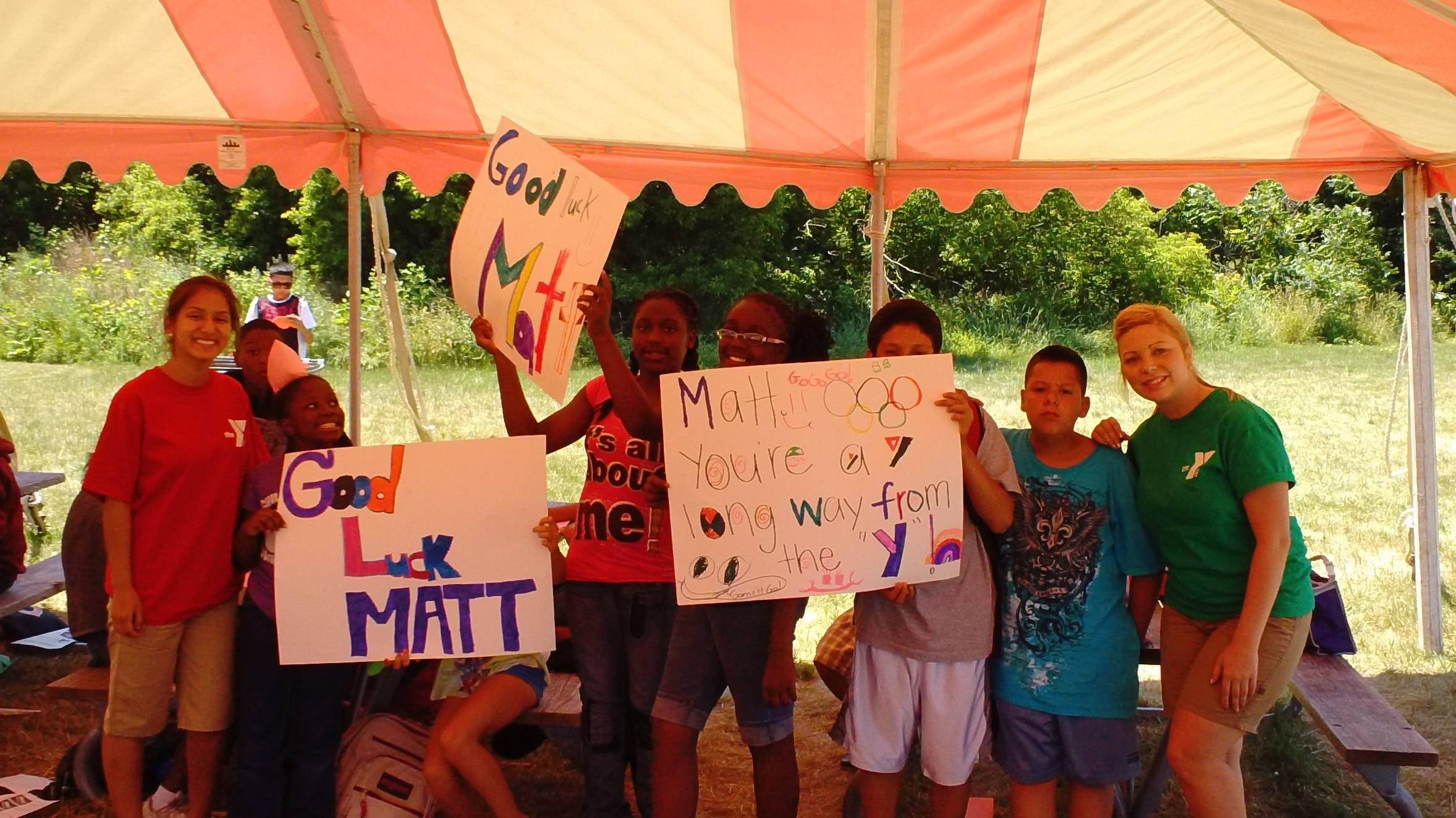Northern Lake YMCA Summer Day Camp participants cheer on Matt Grevers in the Olympic trials.  Grevers' first swim team was the Northern Lake YMCA Seahorses in Waukegan.  Pictured (from left) are Counselor Liliana Buenrostro, Phinas Alexander, Shaqell Lymon, Arielle Cash, Kayla Gibson, Artemio Galindo, Julian Rojel and counselor Janelle Hunt.