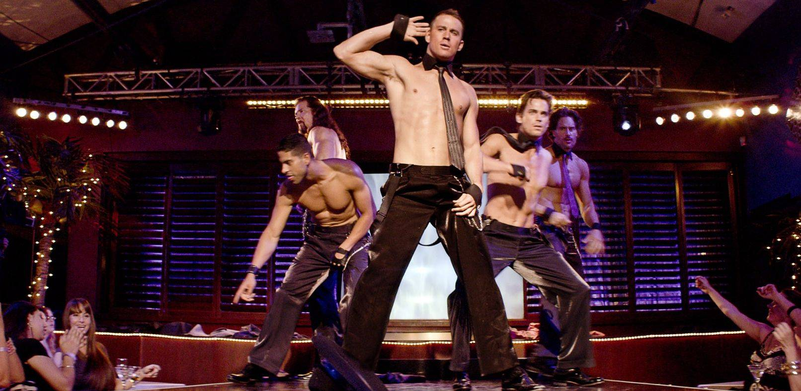 "Professional stripper Mike (Channing Tatum), center, does his stuff for the Xquisite Club in Tampa in Steven Soderbergh's ""Magic Mike,"" based on Tatum's experience in clubs."