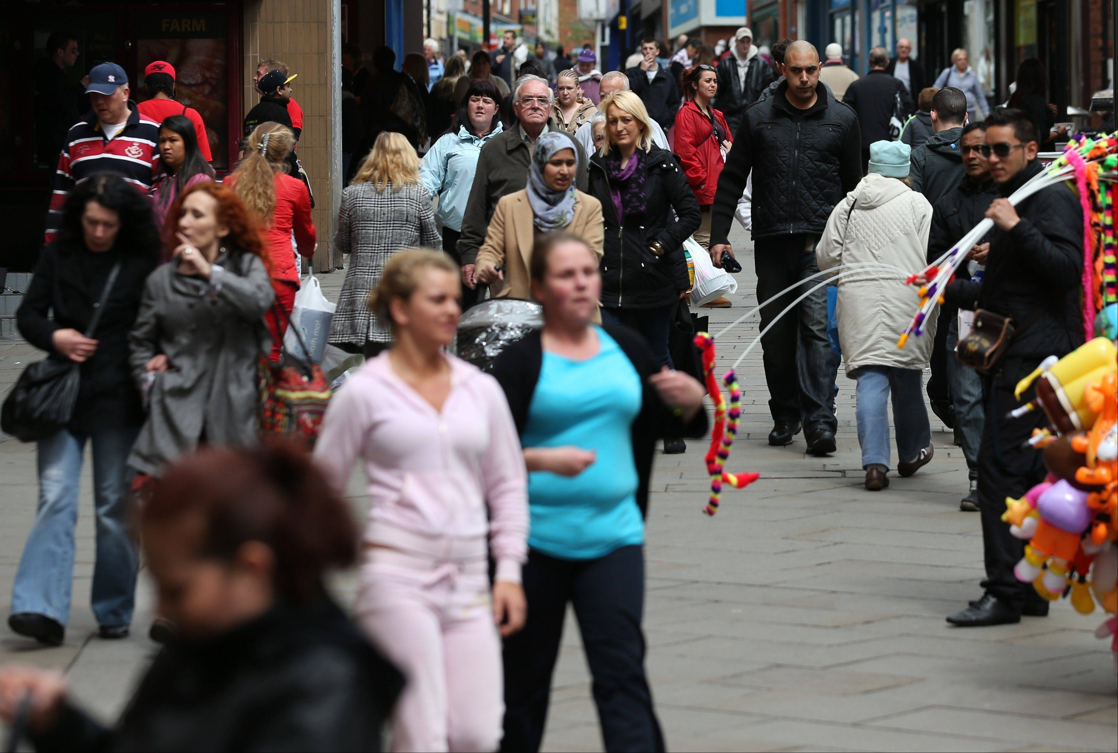 Pedestrians walk through Yorkshire Street in Rochdale, England. Nearly 1 million Pakistanis live in England -- far more than in any other European country -- with about 25,000 settled in the Greater Manchester area that includes Rochdale.
