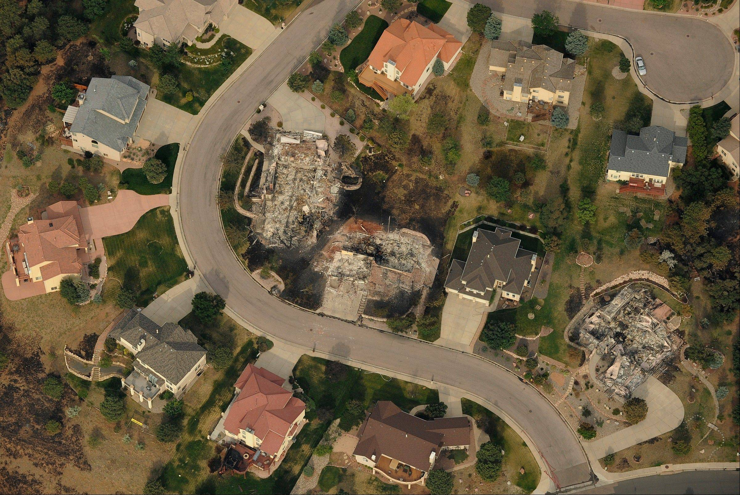 In this aerial photo, homes untouched by the Waldo Canyon fire stand next to the charred lots where neighboring homes were burned to the ground in Colorado Springs, Colo., Thursday. The fire ranks as the worst in the state's history.