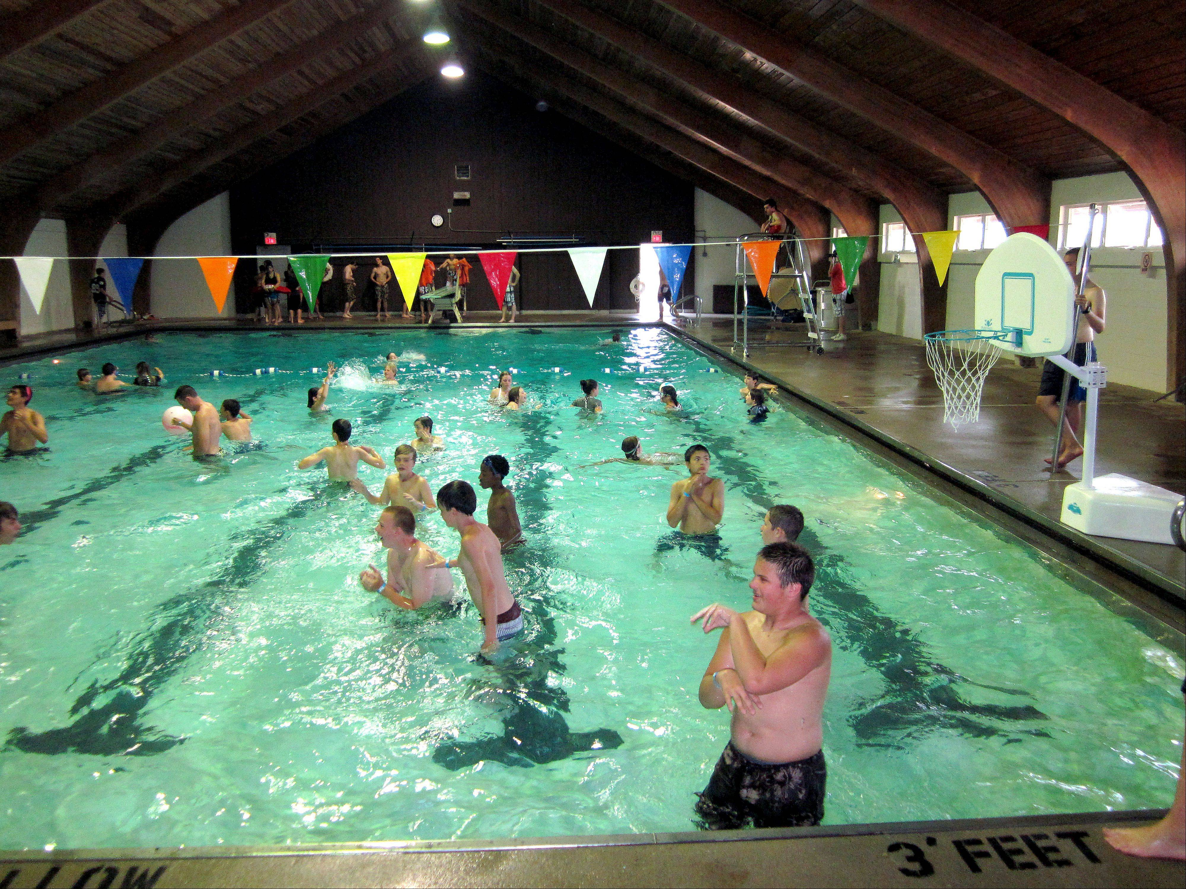 Kids at Camp Duncan YMCA in Ingleside beat the heat by swimming in the climate-controlled, Olympic-sized swimming pool on the campgrounds.