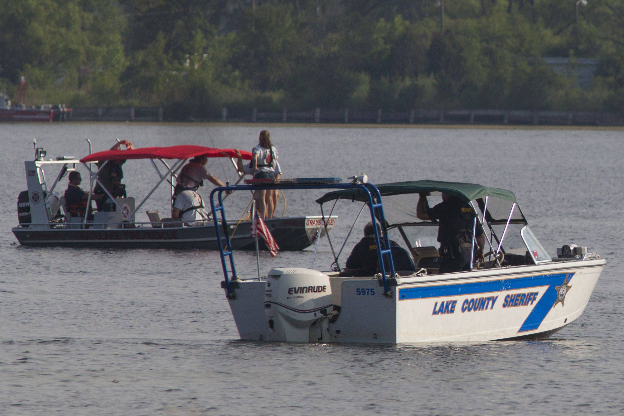 Lake County and Grayslake emergency response teams patrol Loon Lake in search of a 62-year-old man who drowned while swimming off a pontoon boat Thursday afternoon.