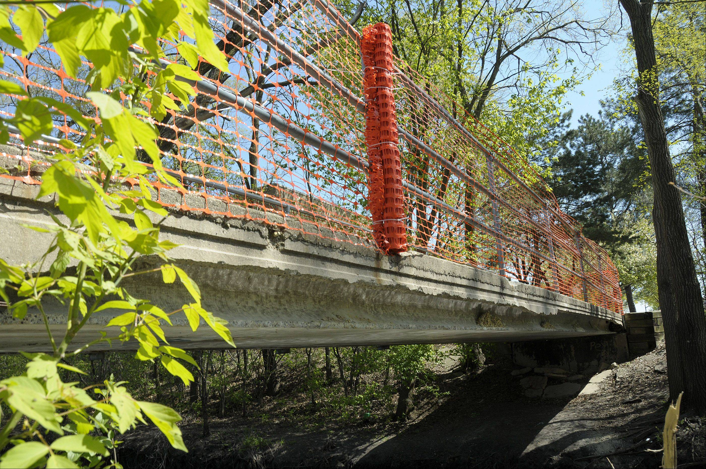 A bridge inspector's report suggests a pedestrian bridge that connects the Carol Stream Library with Armstrong Park be temporarily fixed or permanently replaced.