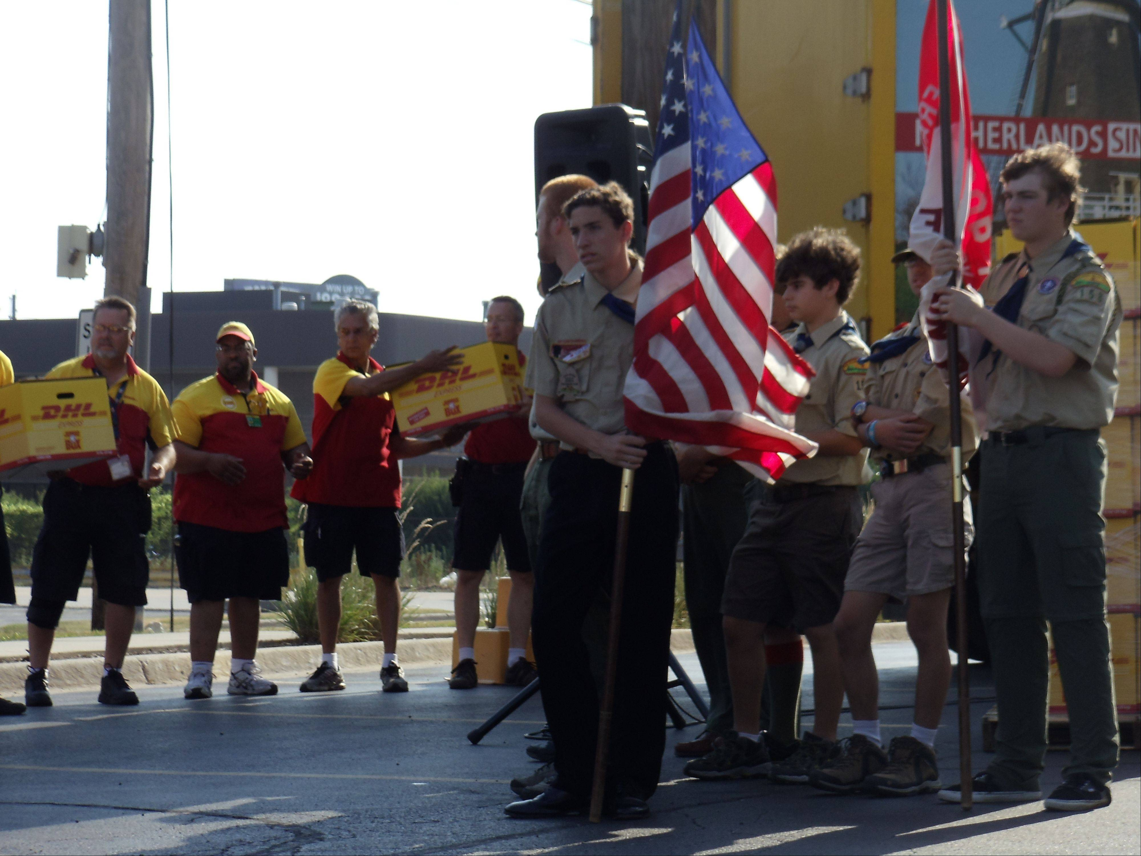 Members of Boy Scout Troop 158 in Franklin Park stand as DHL deliverymen load pizzas onto a semitrailer-truck as part of Pizza 4 Patriots' effort to send 30,000 pizzas to troops Afghanistan just in time for the Fourth of July. The organization was founded by Elk Grove Village resident Mark Evans.