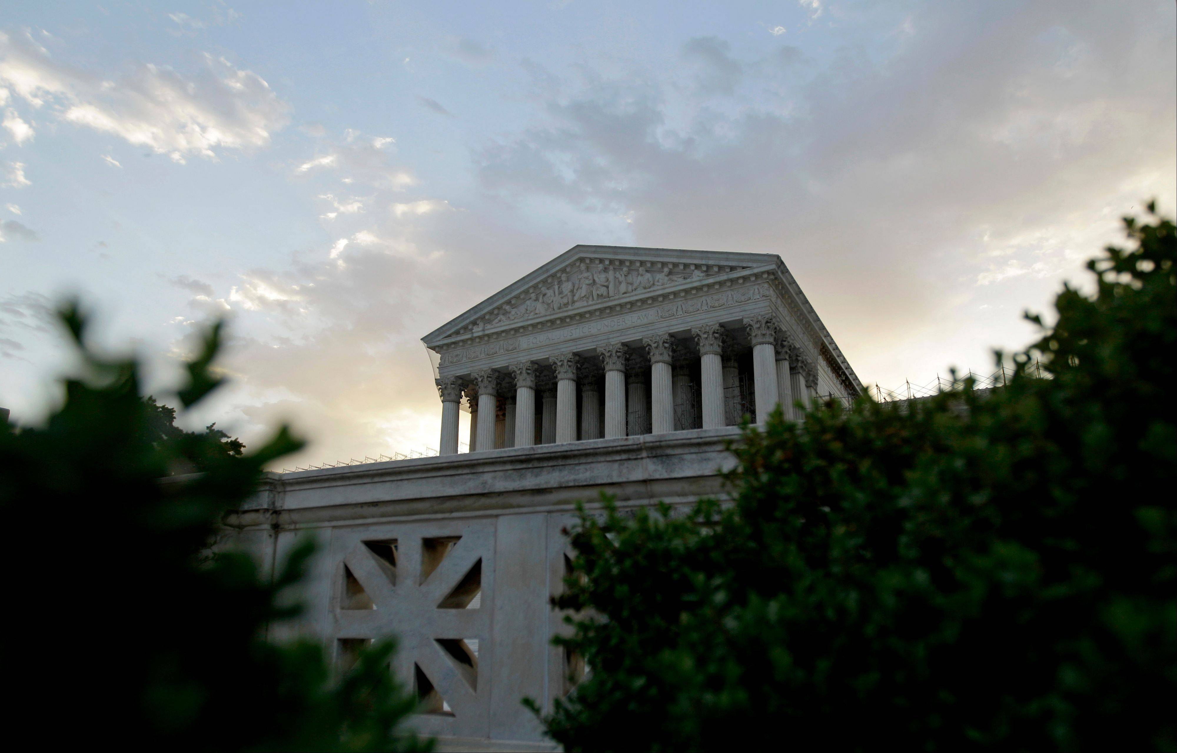 The Supreme Court in Washington, is seen as the sun rises, Thursday, June 28, 2012. Saving its biggest case for last, the Supreme Court is expected to announce its verdict on President Barack Obama's health care law.