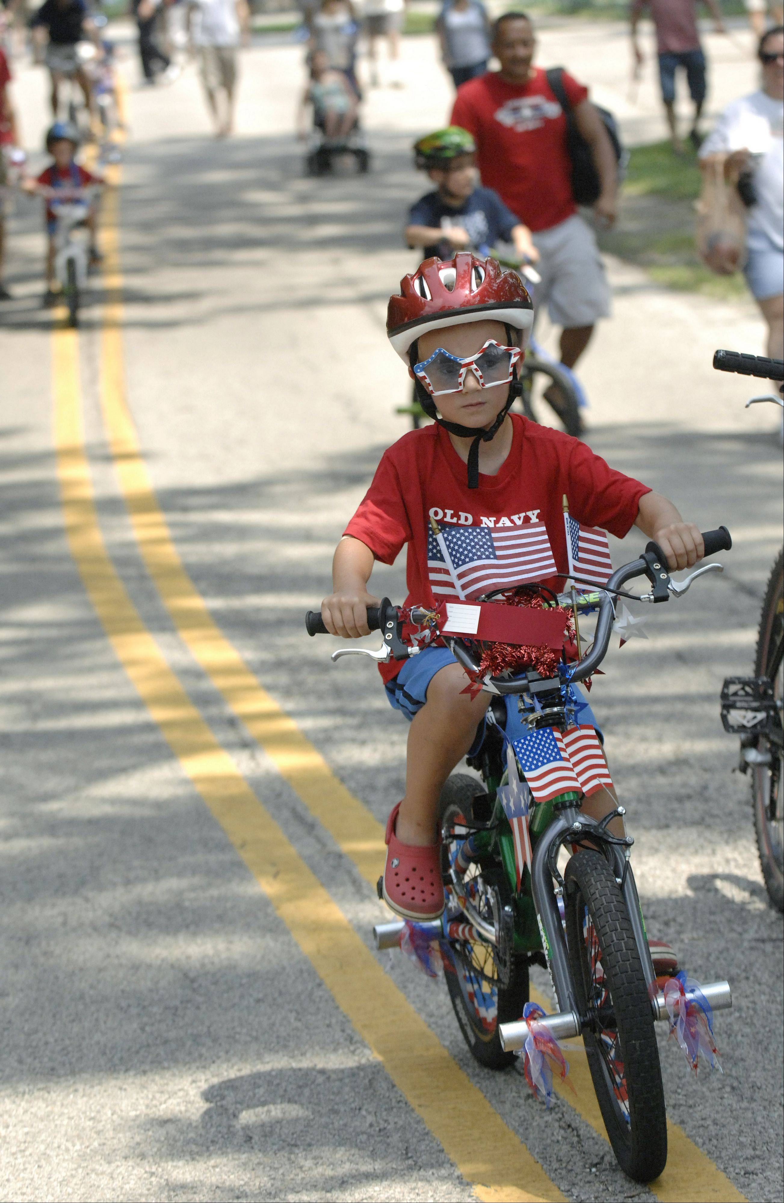 Charlie Carnes of Crystal Lake parades down the path on his decorated bike in the kids bike parade at 2011's Lakeside Festival. Another bike parade will be held Saturday on the third day of this year's fest at Lakeside Legacy Arts Park in Crystal Lake.