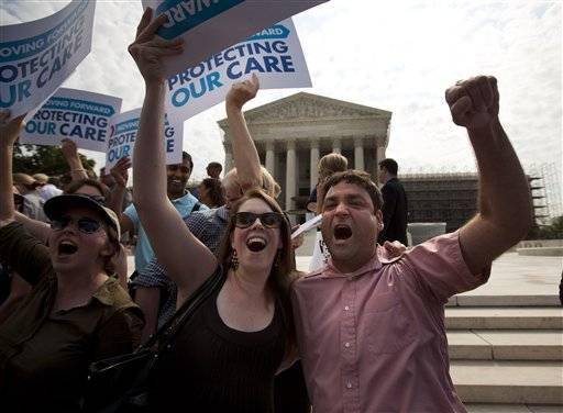 Claire McAndrew of Washington, left, and Donny Kirsch of Washington, celebrate outside the Supreme Court in Washington, Thursday, June 28, 2012, after the court's ruling on health care.