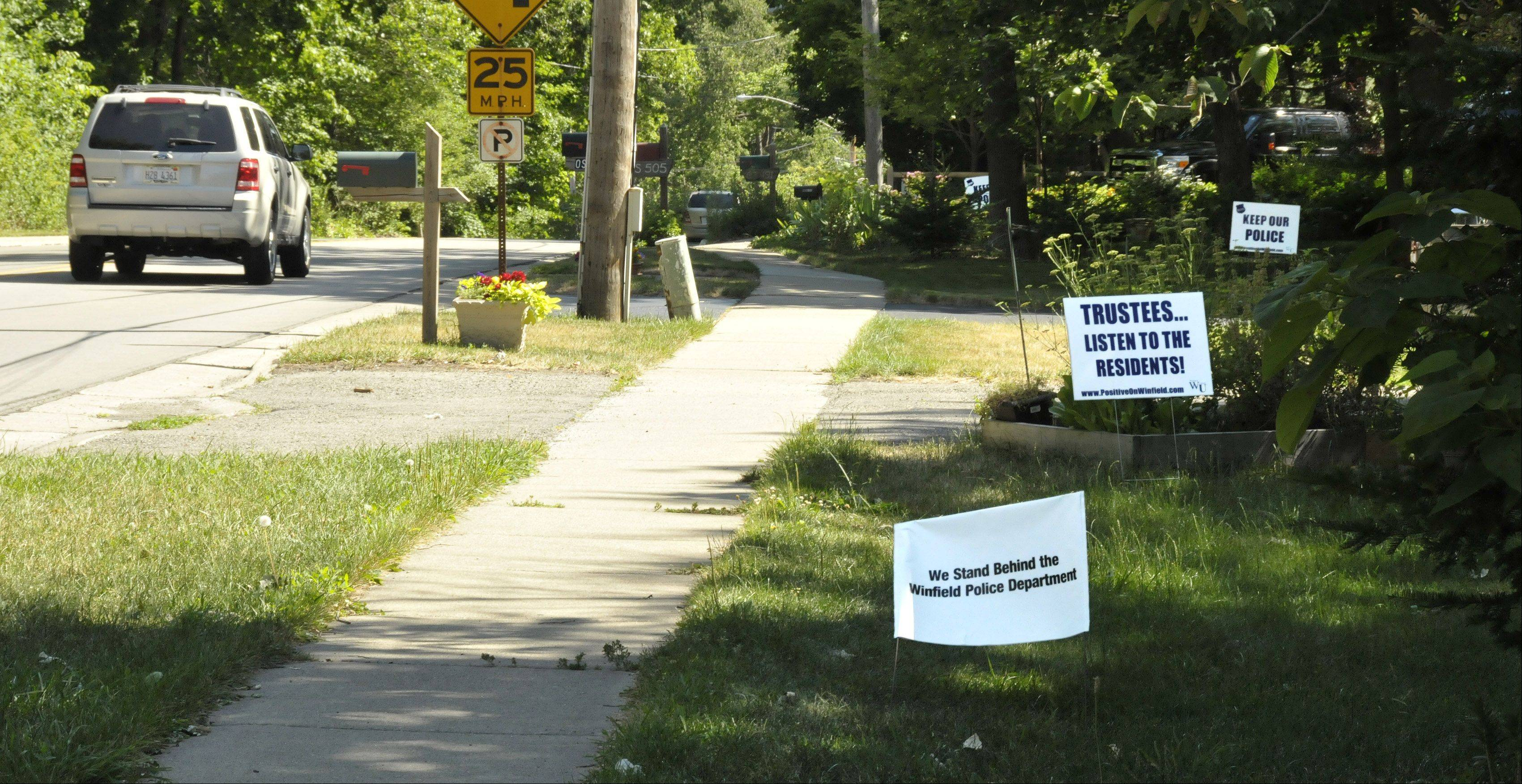 Hundreds of signs expressing support for the Winfield Police Department started appearing throughout the town after it was revealed that the village board is considering the possibility of contracting the county sheriff's office to provide police protection.