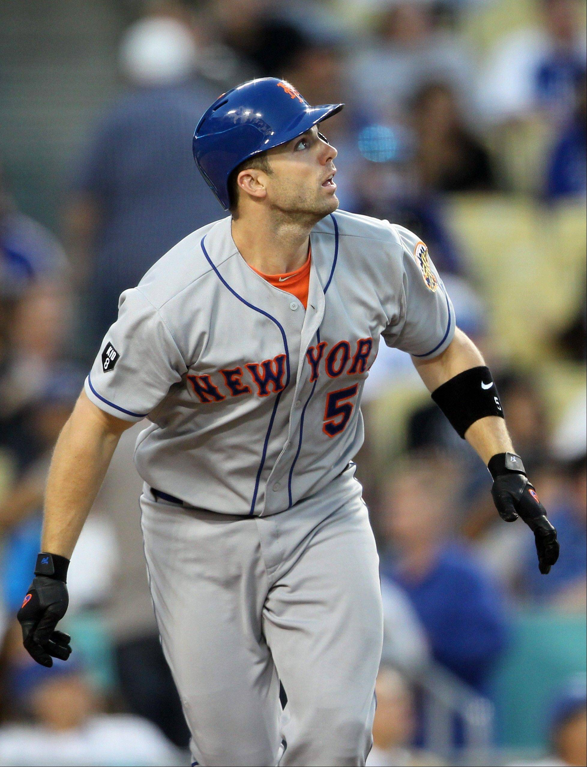 The Mets' David Wright watches his solo home run against the Dodgers in the fourth inning Thursday in Los Angeles.