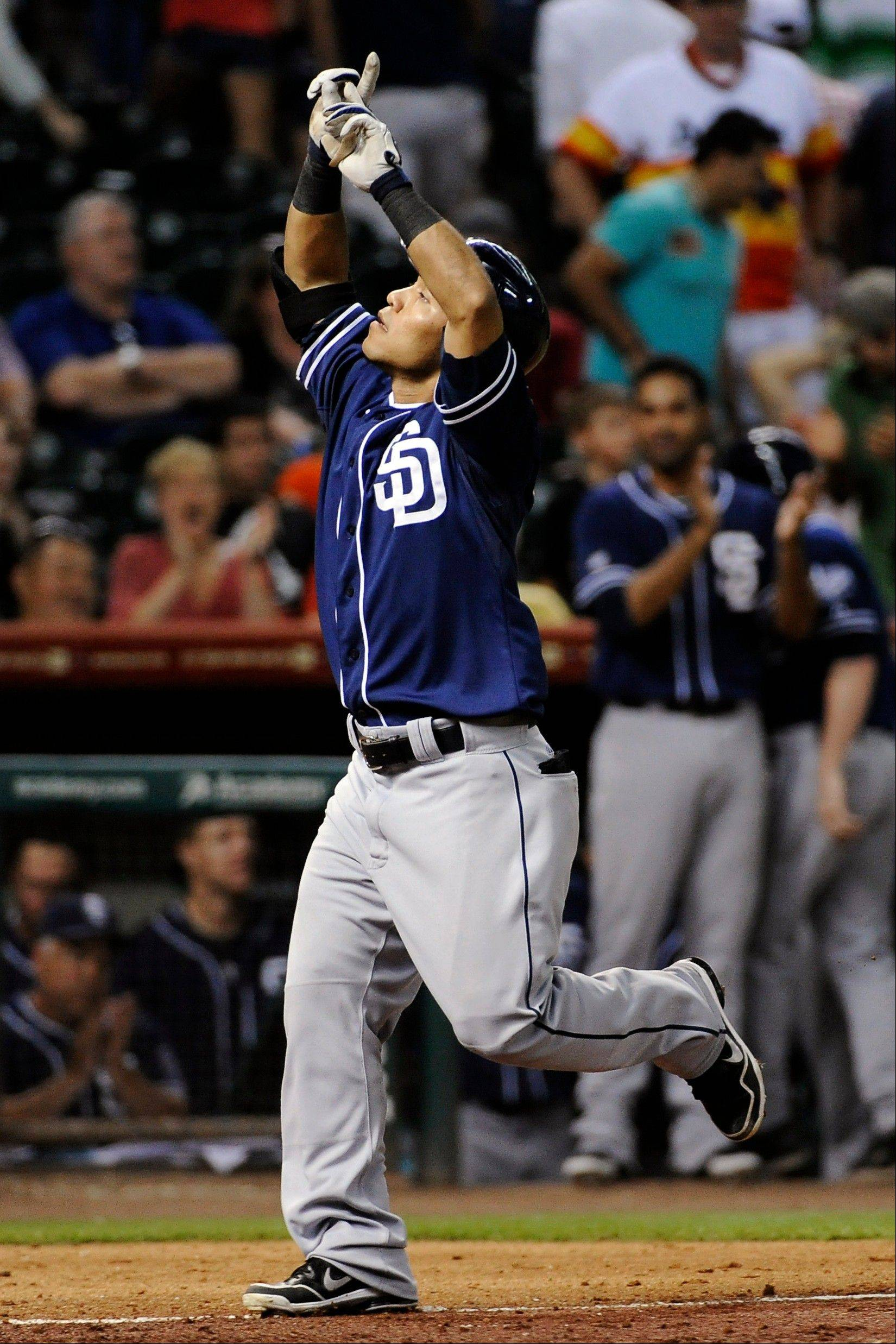 San Diego's Alexi Amarista runs to home plate after hitting a grand slam in the ninth inning Thursday in Houston.