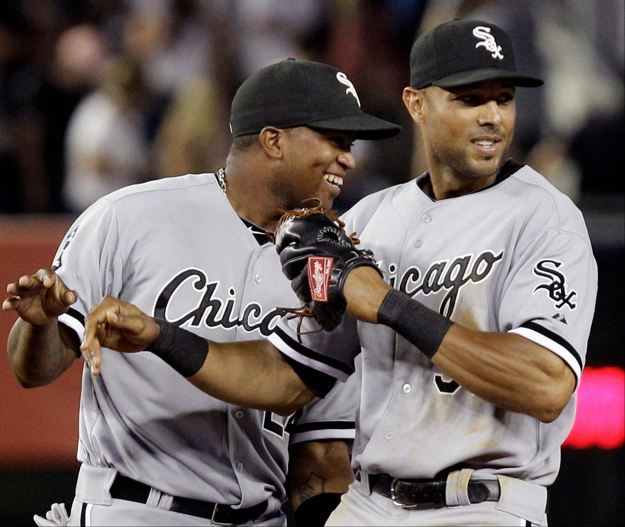 White Sox left fielder Dayan Viciedo, left, and right fielder Alex Rios celebrate after defeating the New York Yankees 4-3 at Yankee Stadium in New York.