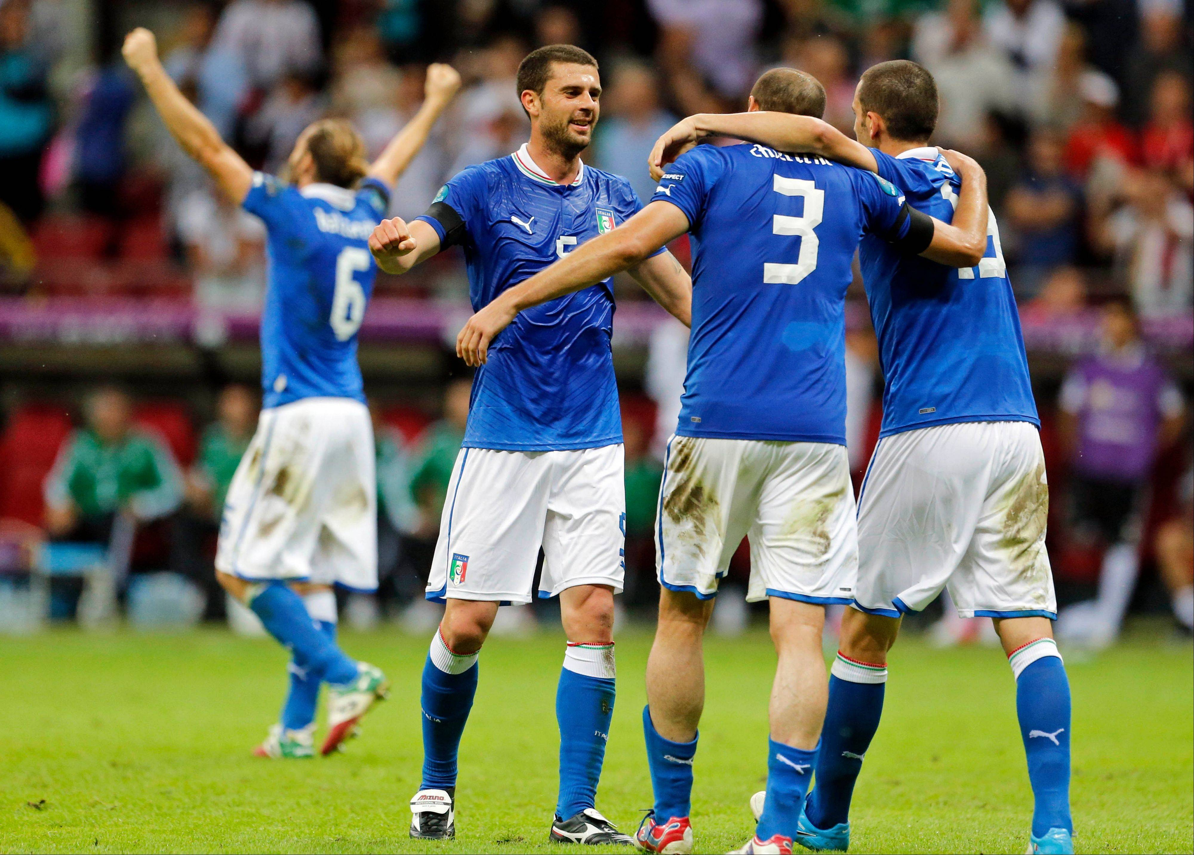 Italian players celebrate Thursday after beating Germany 2-1 in Euro 2012 semifinals in Warsaw, Poland.