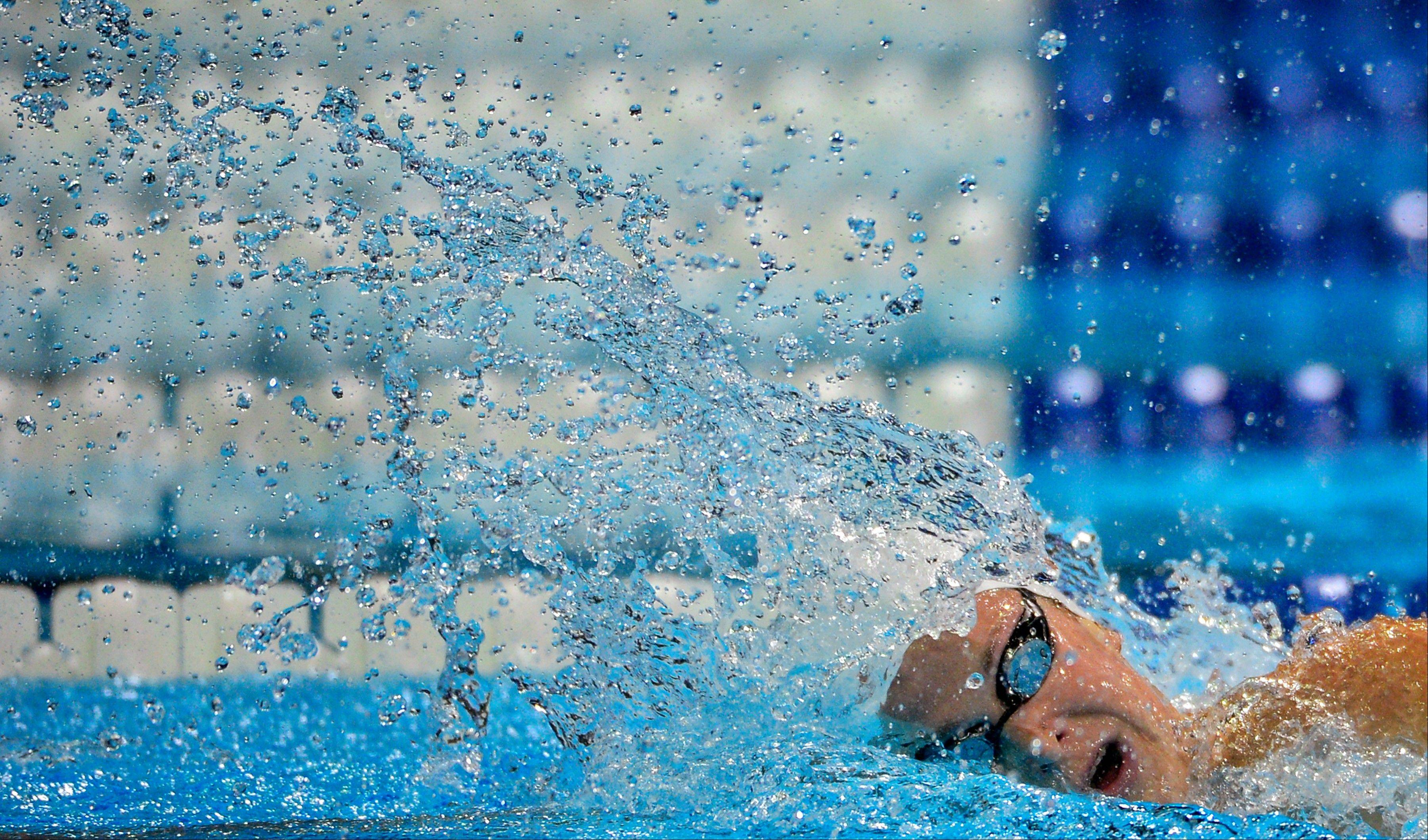 Caitlin Leverenz swims to victory in the women's 200-meter individual medley final at the U.S. Olympic swimming trials Thursday in Omaha, Neb.