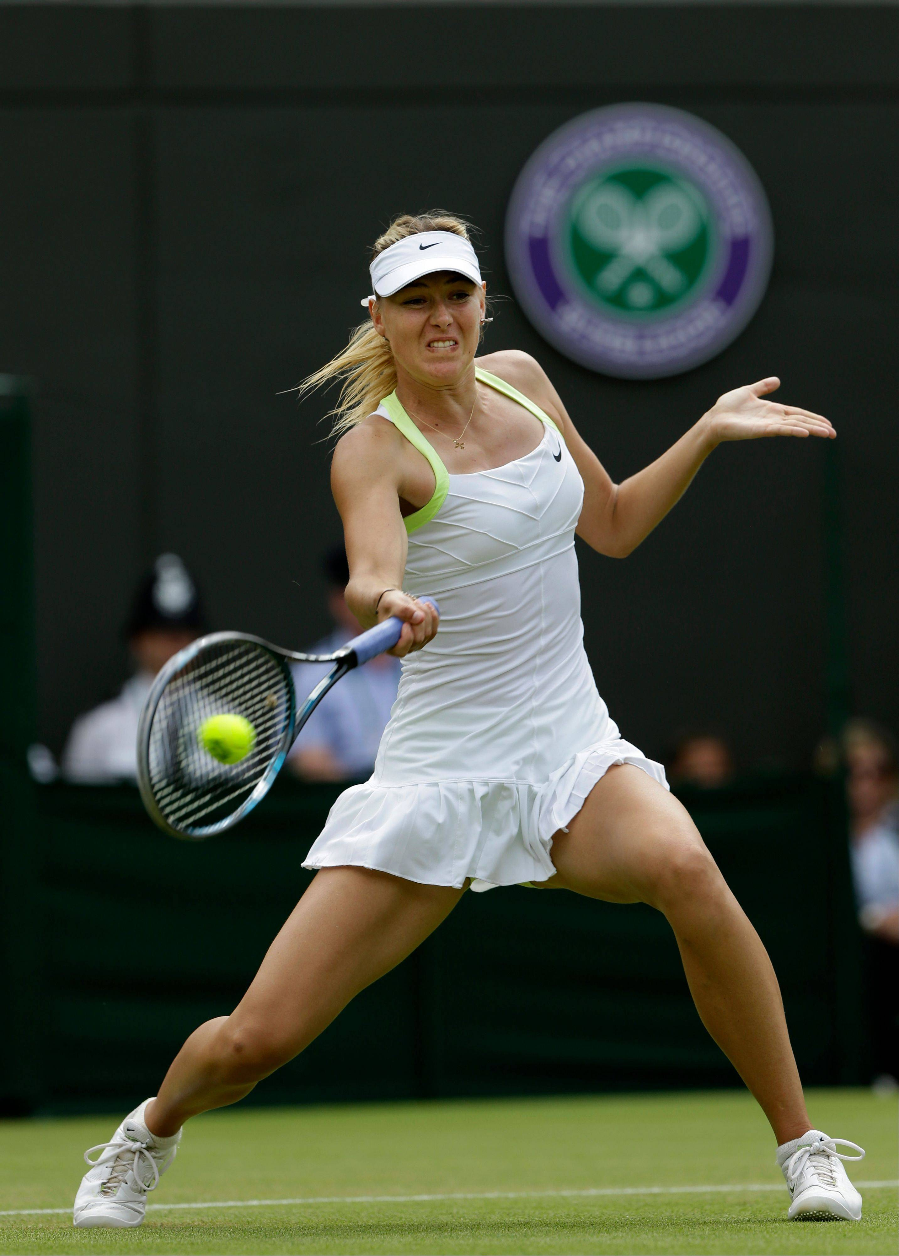 Maria Sharapova of Russia plays a return to Tsvetana Pironkova of Bulgaria during a second round women's singles match at the All England Lawn Tennis Championships at Wimbledon, England, Thursday, June 28, 2012.