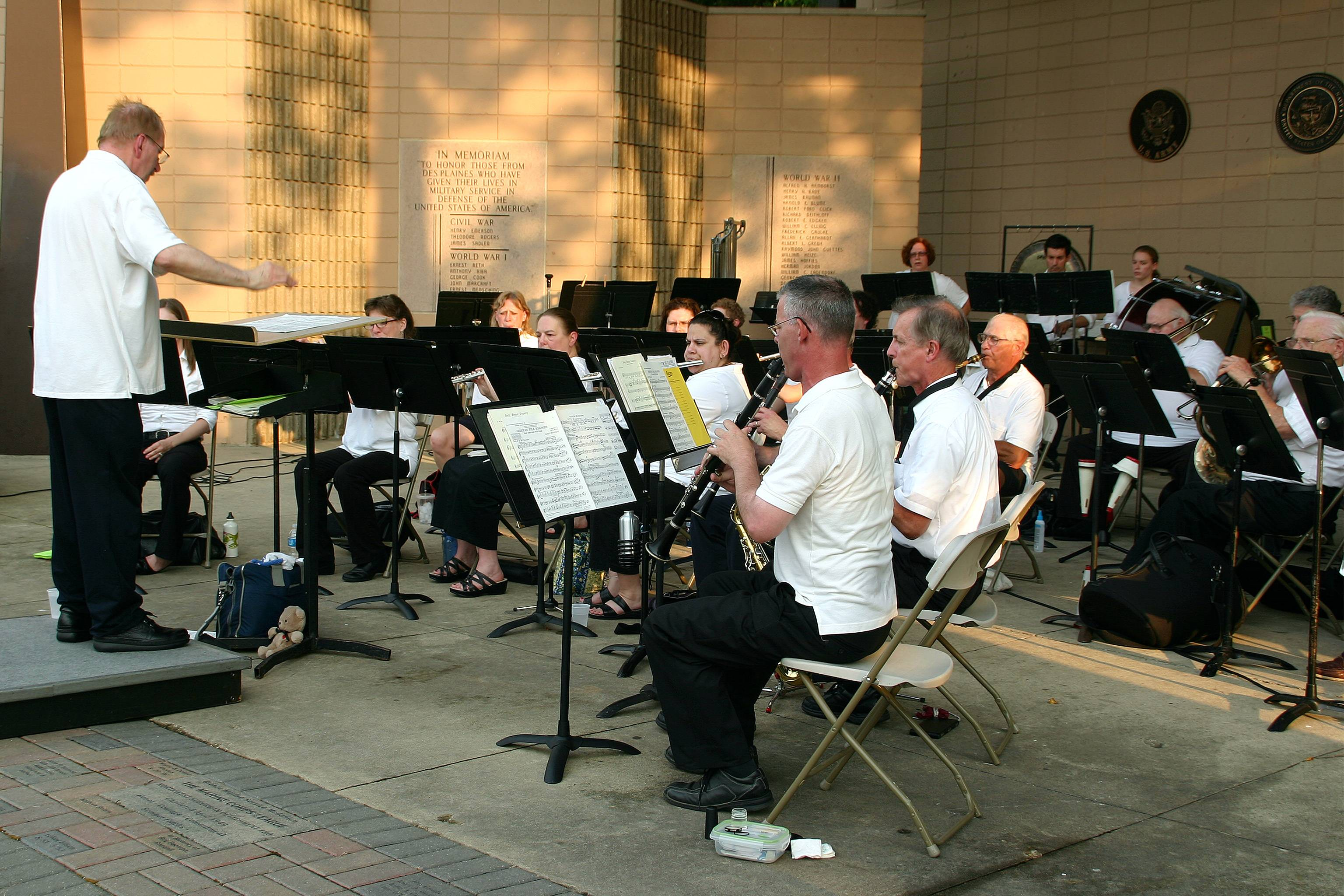 The Des Plaines Community Concert Band under the direction of Larry J. Carle performs at the Lake Park Memorial Pavilion on June 28.