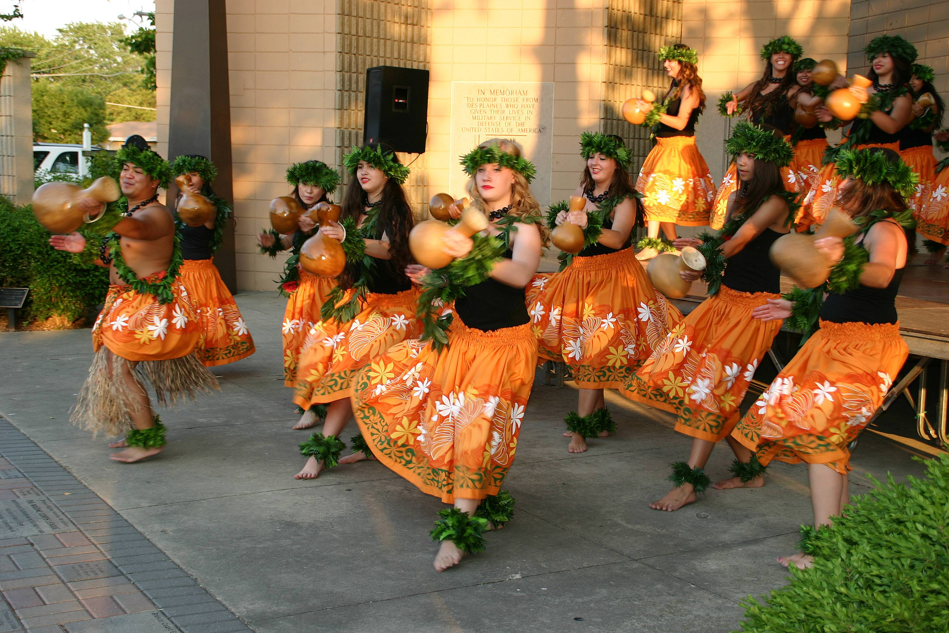 The Barefoot Hawaiian perform a traditional hula using the ipu gourde drum at the first of the free Live at the Lake summer concerts at the Lake Park Memorial Pavilion on June 27.