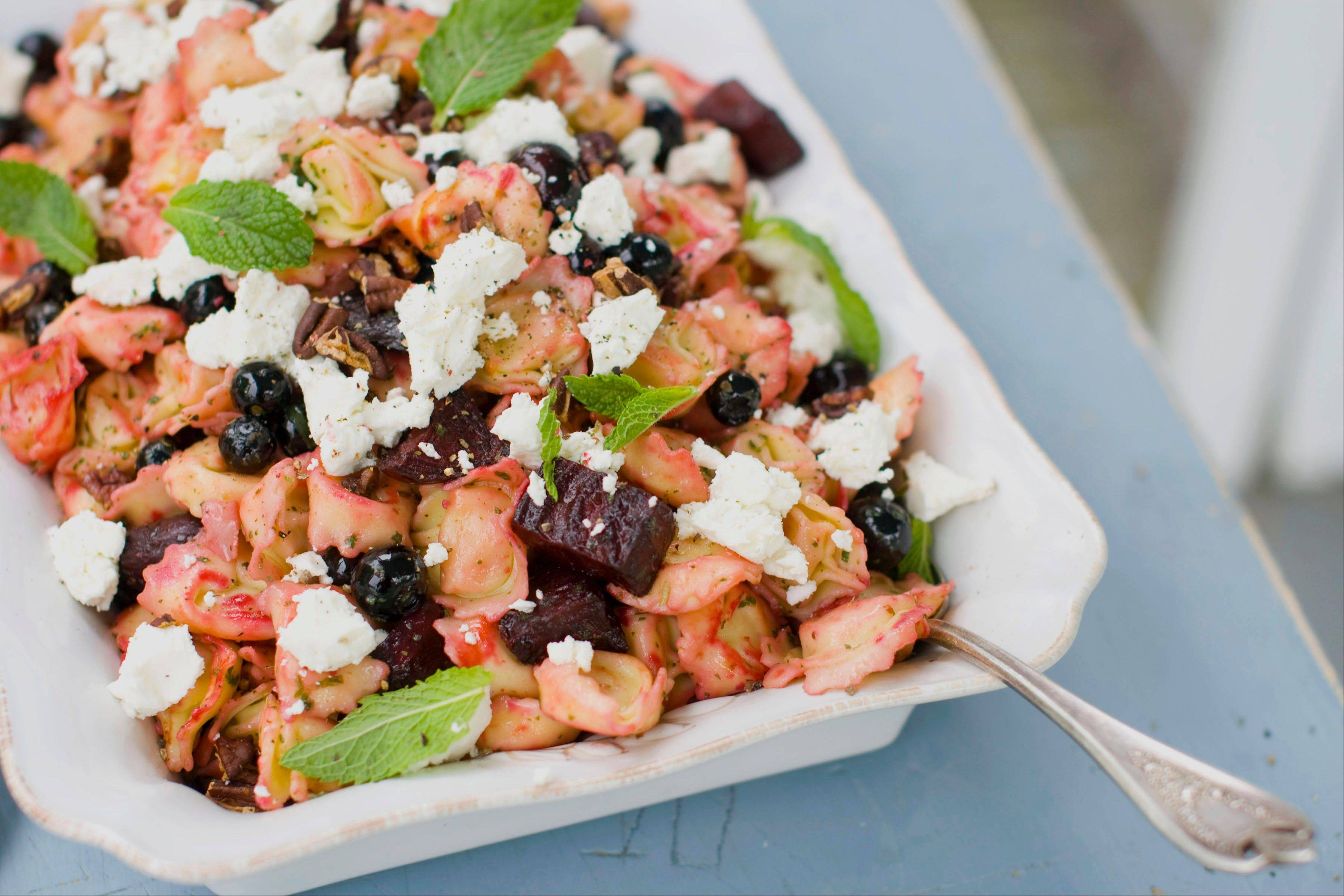 Roasted beets add color and sweetness to this tortellini salad with fresh blueberries and soft goat cheese.