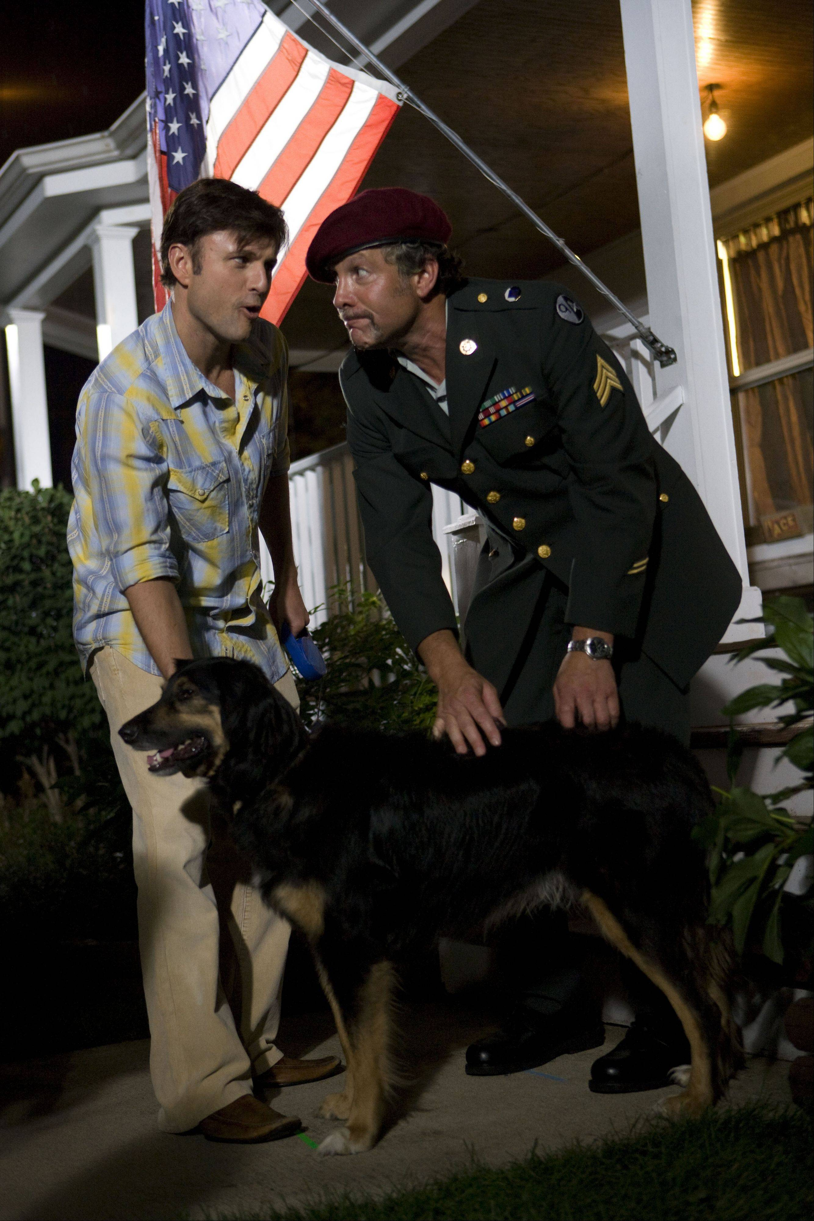 "J.T. (Steve Lemme), left, entrusts the care of his beloved dog to a seemingly honorable Marine (Steve Guttenberg) in the locally shot comedy ""I Heart Shakey."""