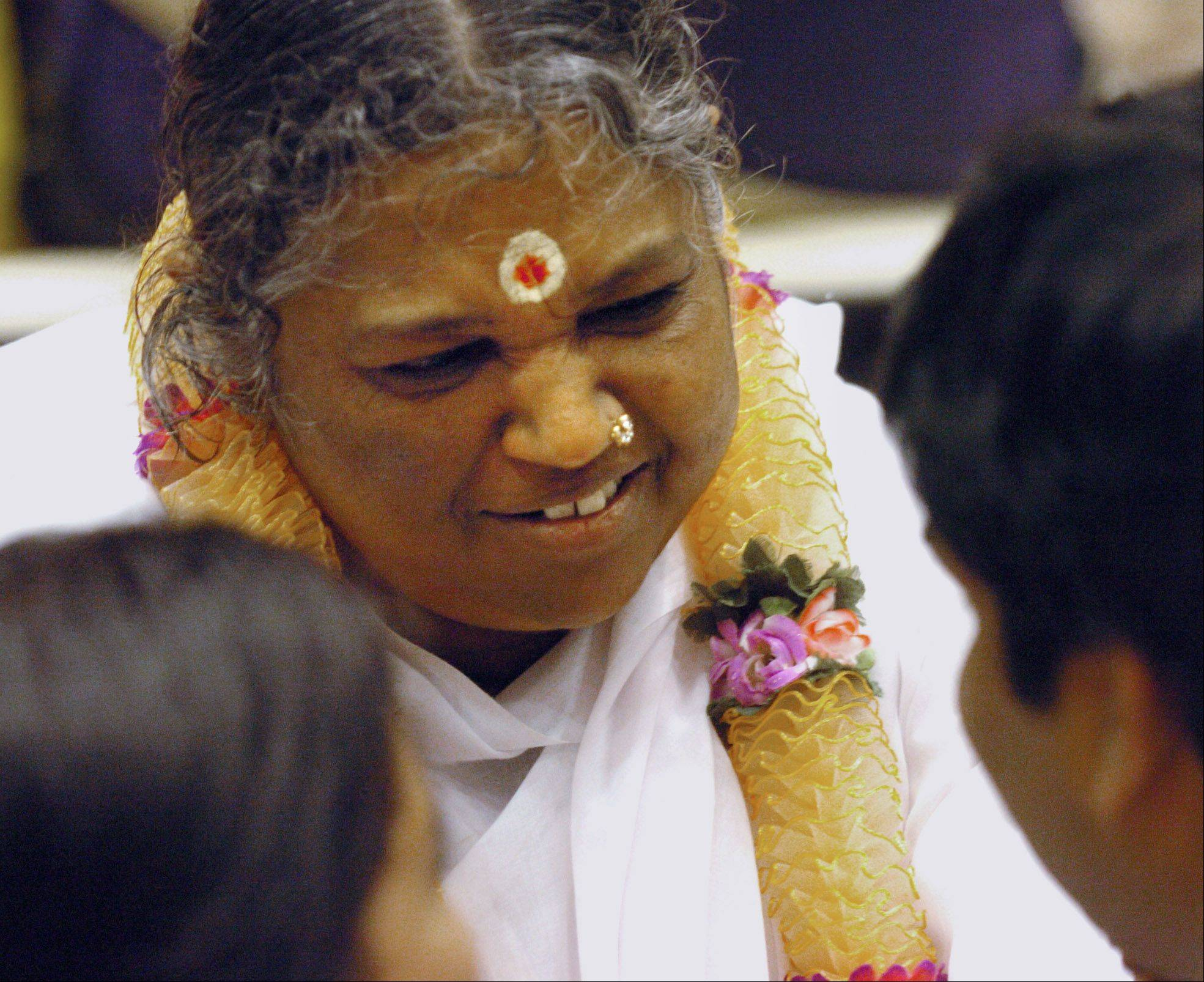 Hindu spiritual leader Mata Amritanandamayi is expected to help inaugurate a La Fox religious center named in her honor during a five-day program that begins Saturday. Her visit comes as authorities continue to investigate how a fire started in the center's administration building Thursday.