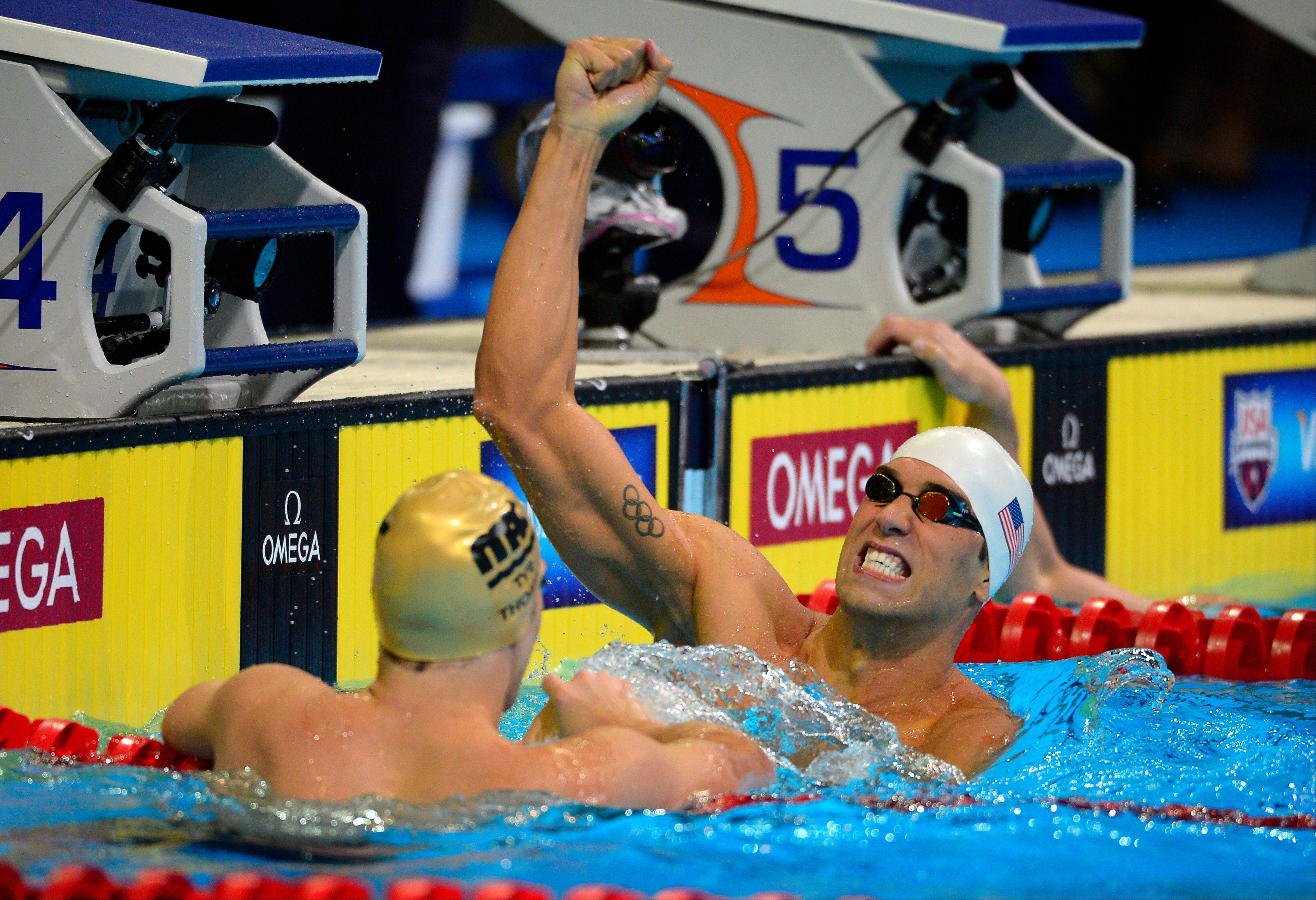 Matt Grevers, right, celebrates winning the men's 100-meter backstroke final at the U.S. Olympic swimming trials on Wednesday in Omaha, Neb.