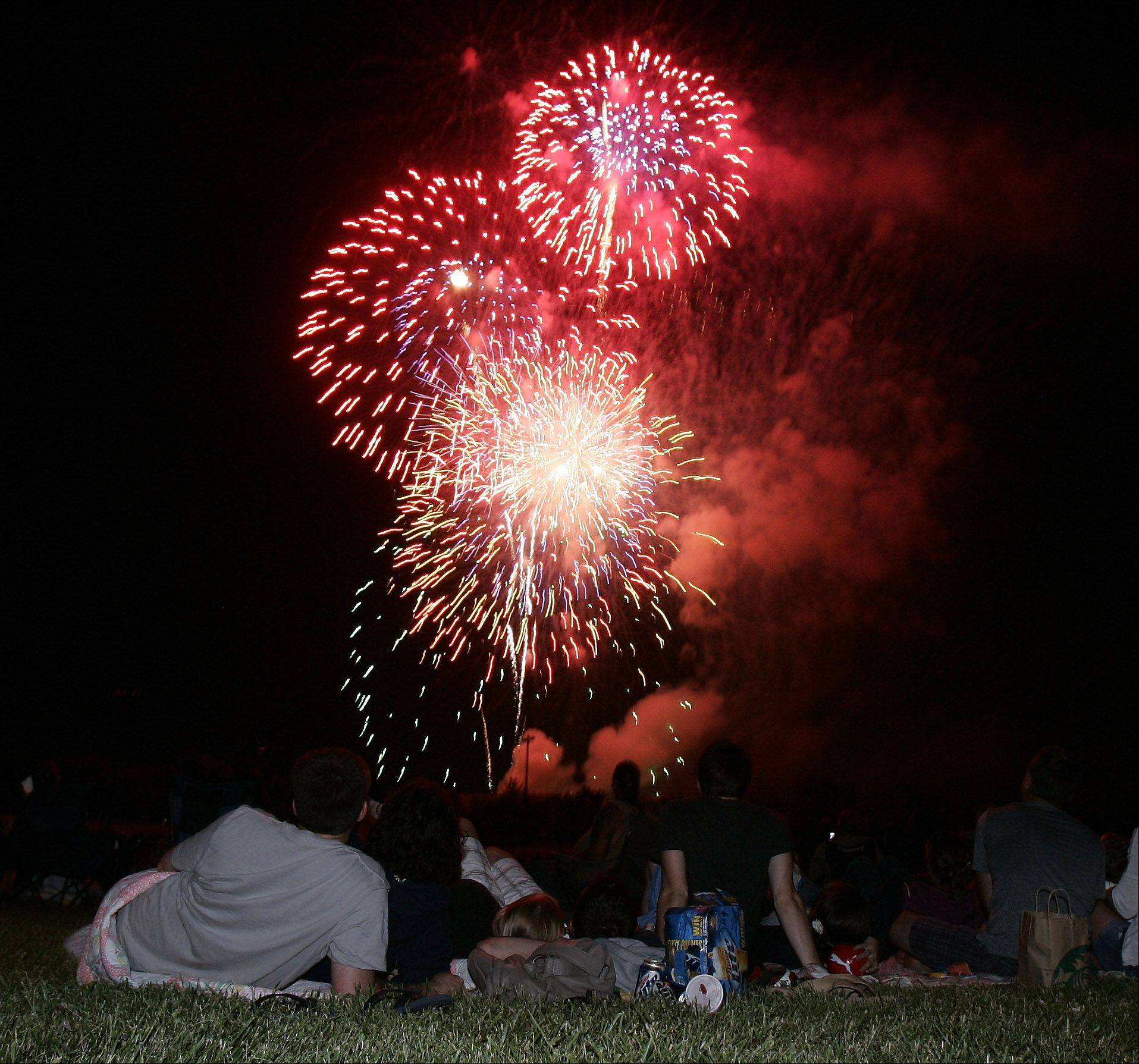 Residents watch the end of the show during the Wauconda fireworks at Cook Park last year.