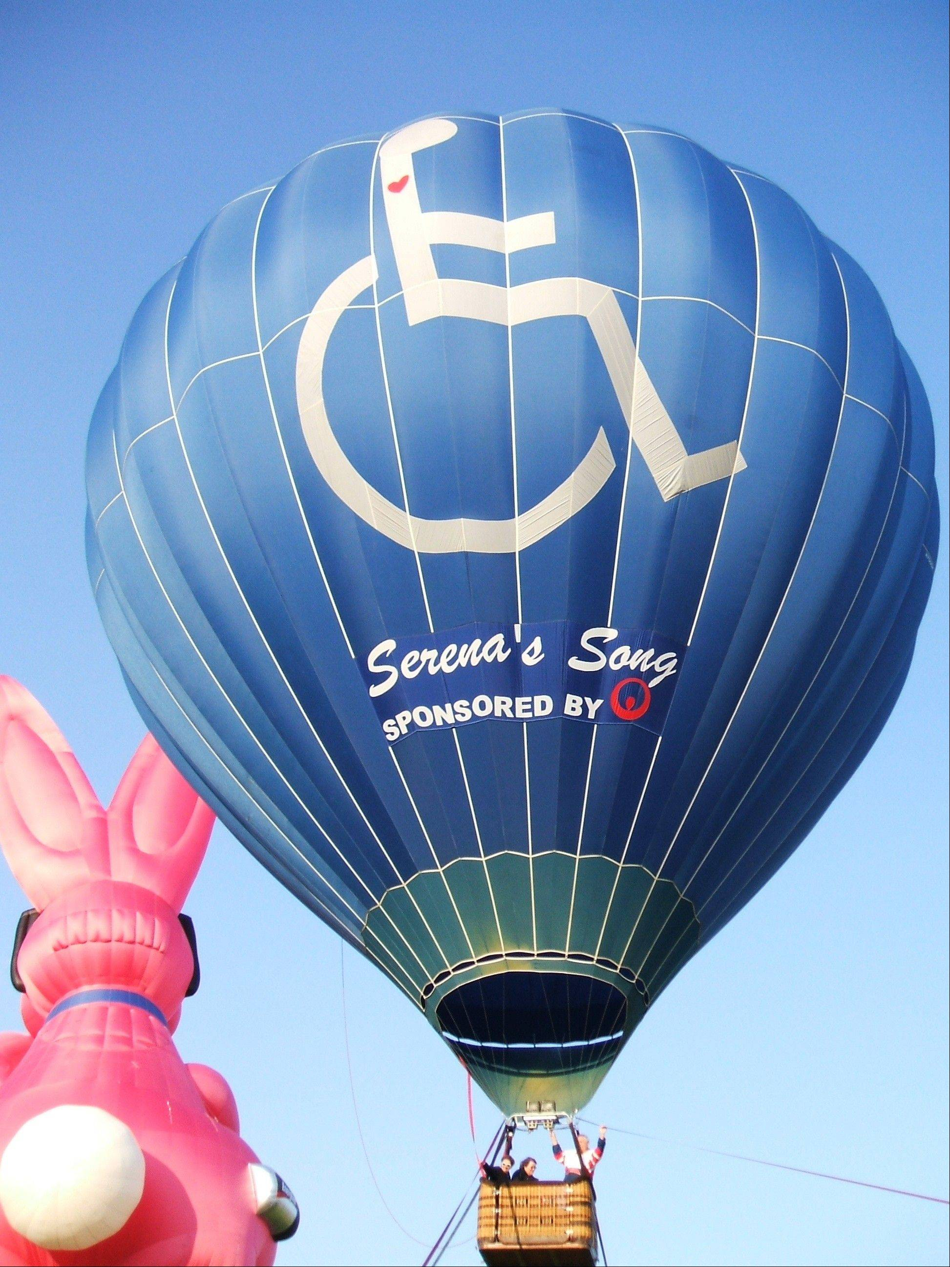 Serena's Song bears a distinctive logo of a person in a wheelchair with a red heart. The wheelchair-accessible hot air balloon offers free tethered rides to children and adults with disabilities while it visits Lisle's Eyes to the Skies festival.