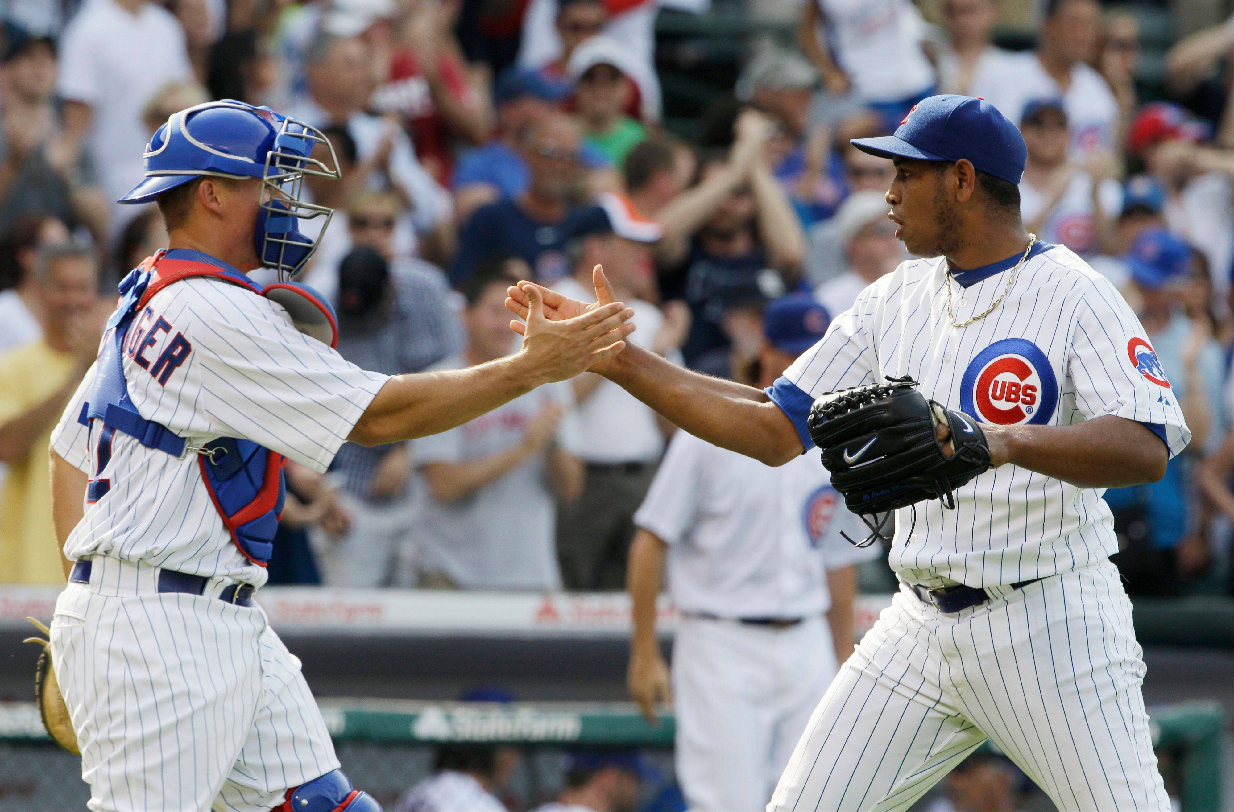 Cubs closer Carlos Marmol, right, celebrates with catcher Steve Clevenger after beating the Houston Astros 4-0 Friday. Starter Paul Maholm pitched into the ninth before Marmol closed out the game.