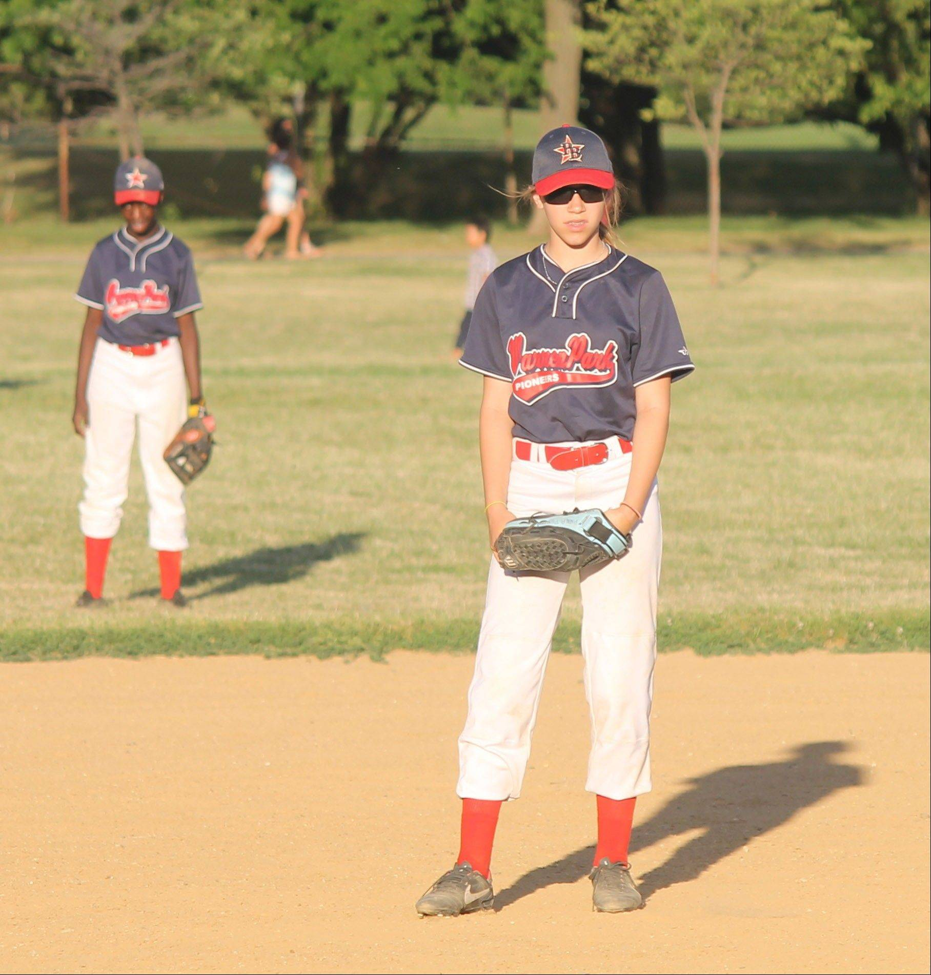 Infielder Anna Perona of the Warren Park Pioneers girls baseball team prefers baseball over softball. This summer she'll get a chance to play in a national tournament at Cooperstown, N.Y., with a Chicago travel team.