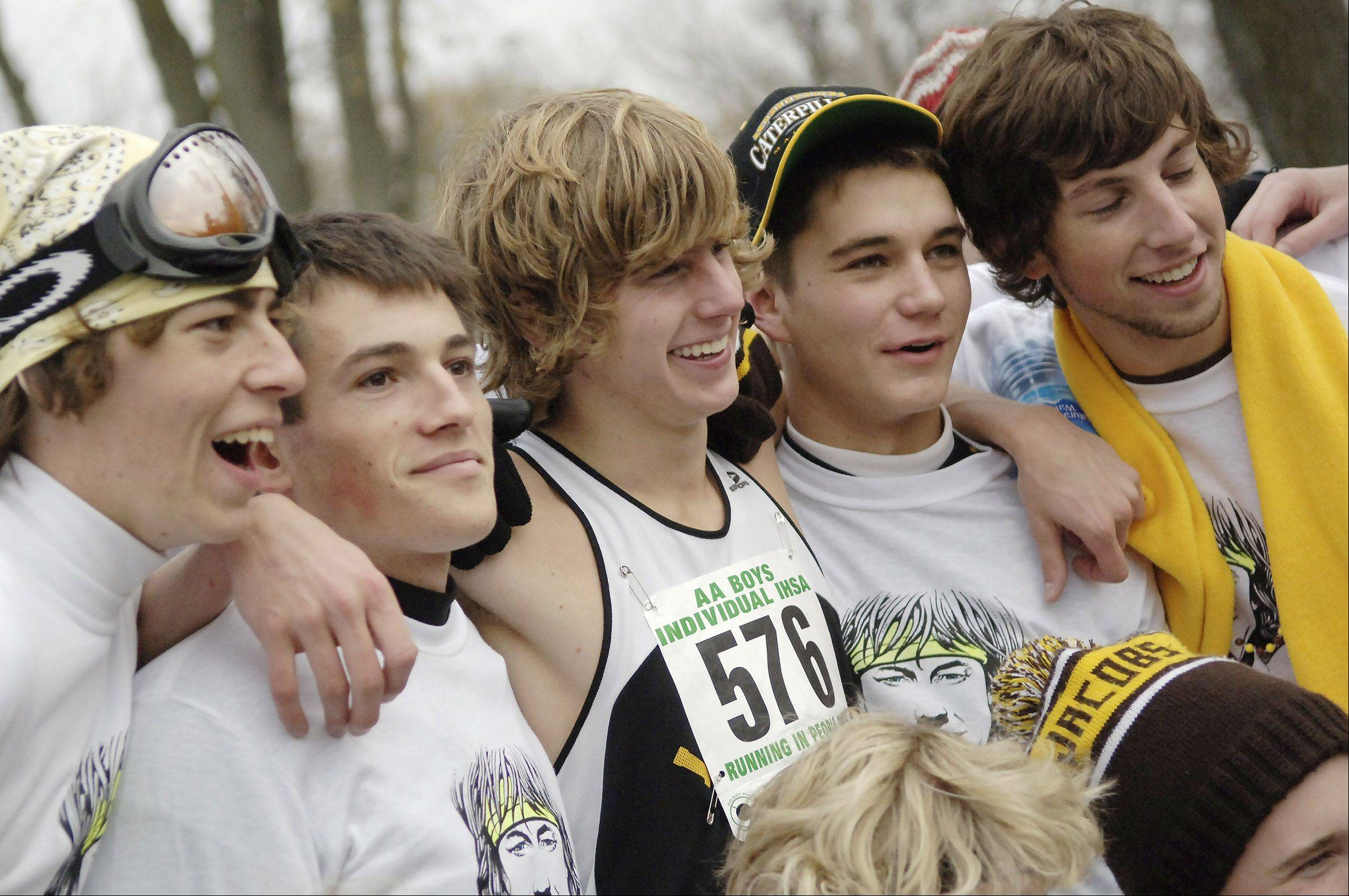 Evan Jager, center, is flanked by friends and supporters after his state cross country title win in Peoria.