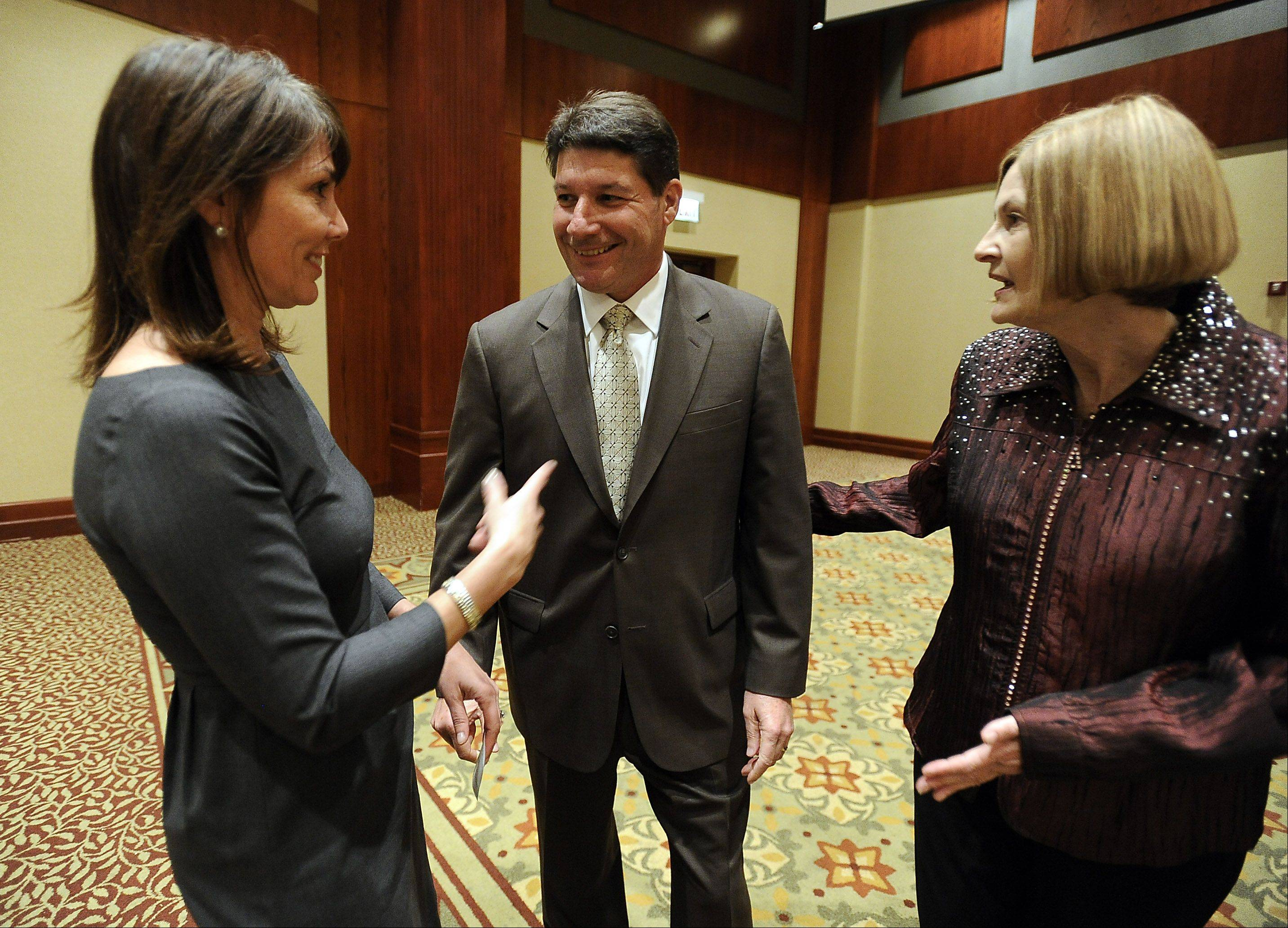"""Business Leader of the Year"" Jeff Palombo and Ellen Hamilton, left, both from Northrop Grumman Corp., with Rolling Meadows chamber director Linda Ballentine, at the 2012 Circles of Success dinner earlier this year"