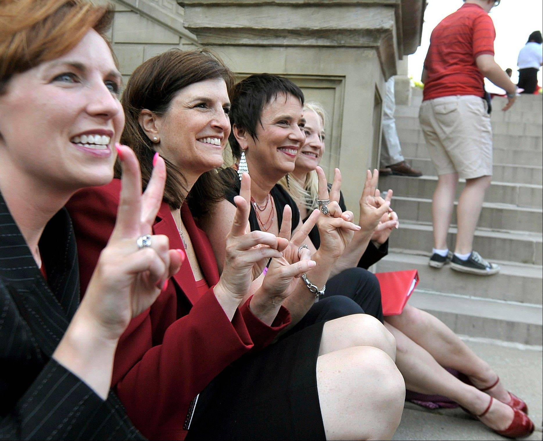 "From left, Rep. Barb Byrum, D-Onondaga; Rep. Lisa Brown, D-West Bloomfield; playwright Eve Ensler; and Sen. Rebecca Warren, D-Ann Arbor, pose for a group picture June 18 during an event including a performance of ""The Vagina Monologues"" by Brown and 10 other lawmakers on the Michigan Statehouse steps, in Lansing, Mich. Brown, who says she was barred from speaking in the Michigan House because Republicans objected to her saying ""vagina"" during debate over anti-abortion legislation, performed ""The Vagina Monologues"" with a hand from the author Eve Ensler."