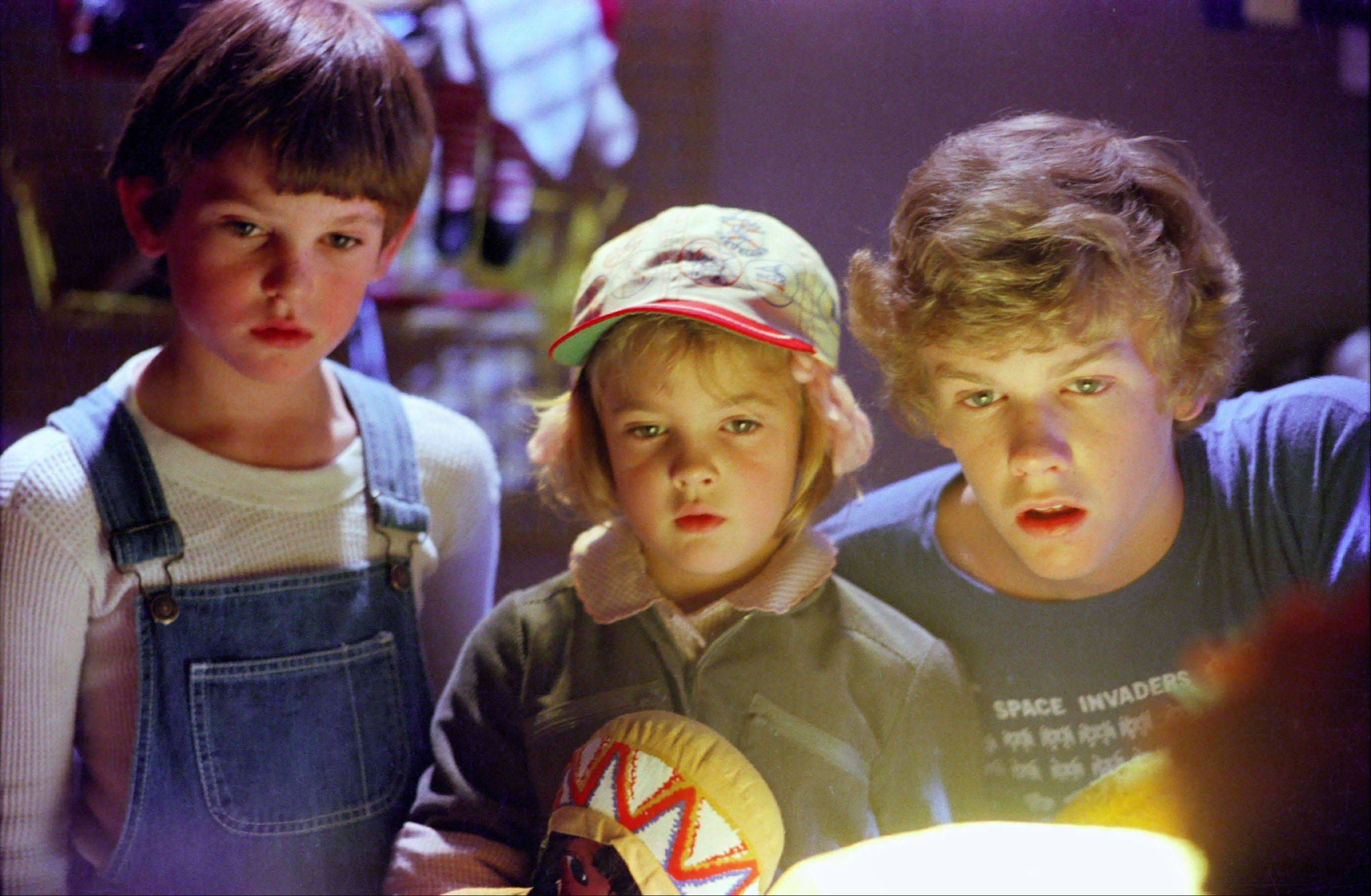 "Actors, from left, Henry Thomas, Drew Barrymore and Robert MacNaughton in a scene from the film, ""E.T.: The Extra- Terrestrial."" It was way back in 1982 when the boy in ""E.T.: The Extra-Terrestrial,"" one of the most beloved family films of all time, called his annoying brother ""penis breath"" _ gaining the instant admiration of legions of fellow youngsters. Only now, a full 30 years later, is the V-word beginning to surface regularly in mainstream entertainment, popping up in some network TV shows, with references in advertising as well."