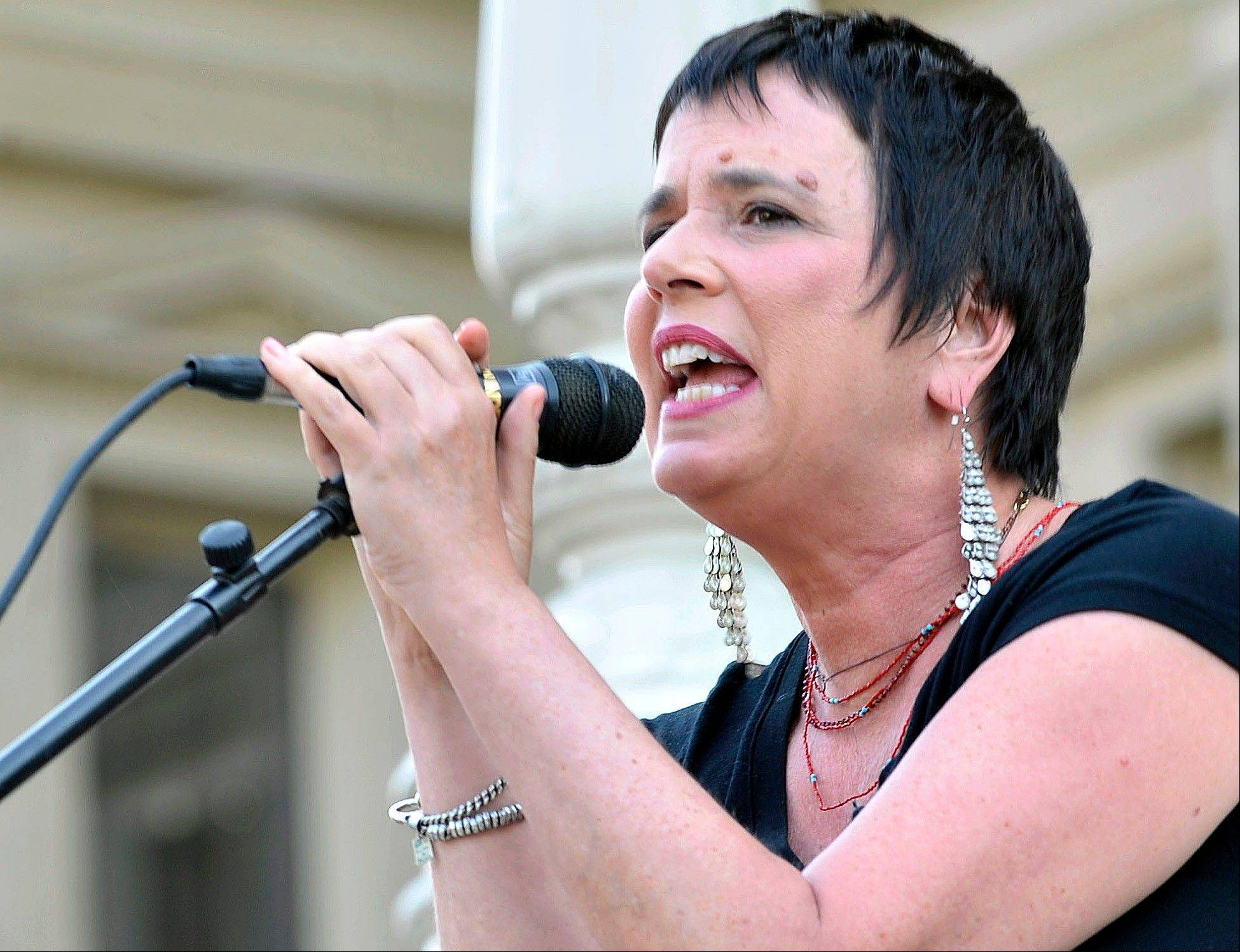 "Eve Ensler, author of ""The Vagina Monologues,"" speaks during a June 18 performance of her play by Democratic state Rep. Lisa Brown, 10 other lawmakers and several actresses on the Michigan Statehouse steps, in Lansing, Mich. Brown, who says she was barred from speaking in the Michigan House because Republicans objected to her saying ""vagina"" during debate over anti-abortion legislation, performed with help from author Ensler."