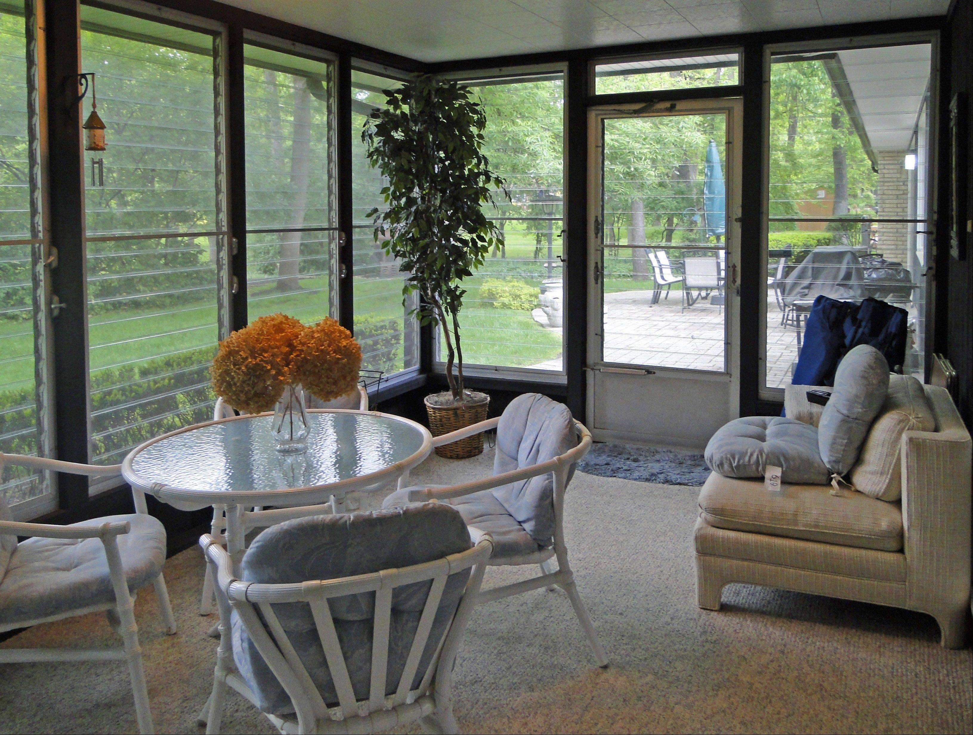 This sunroom allows owners to enjoy views of the half-acre lot.