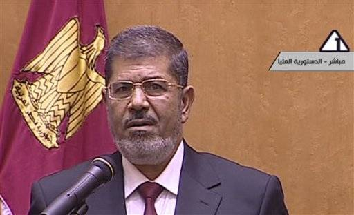 In this image made from Egyptian State Television, Egyptian President Mohammed Morsi makes remarks after he was sworn in at the Supreme Consitutional Court in Cairo, Egypt, Saturday, June 30, 2012. Islamist Mohammed Morsi has been sworn in before Egypt's highest court as the country's first freely elected president, succeeding Hosni Mubarak who was ousted 16 months ago.