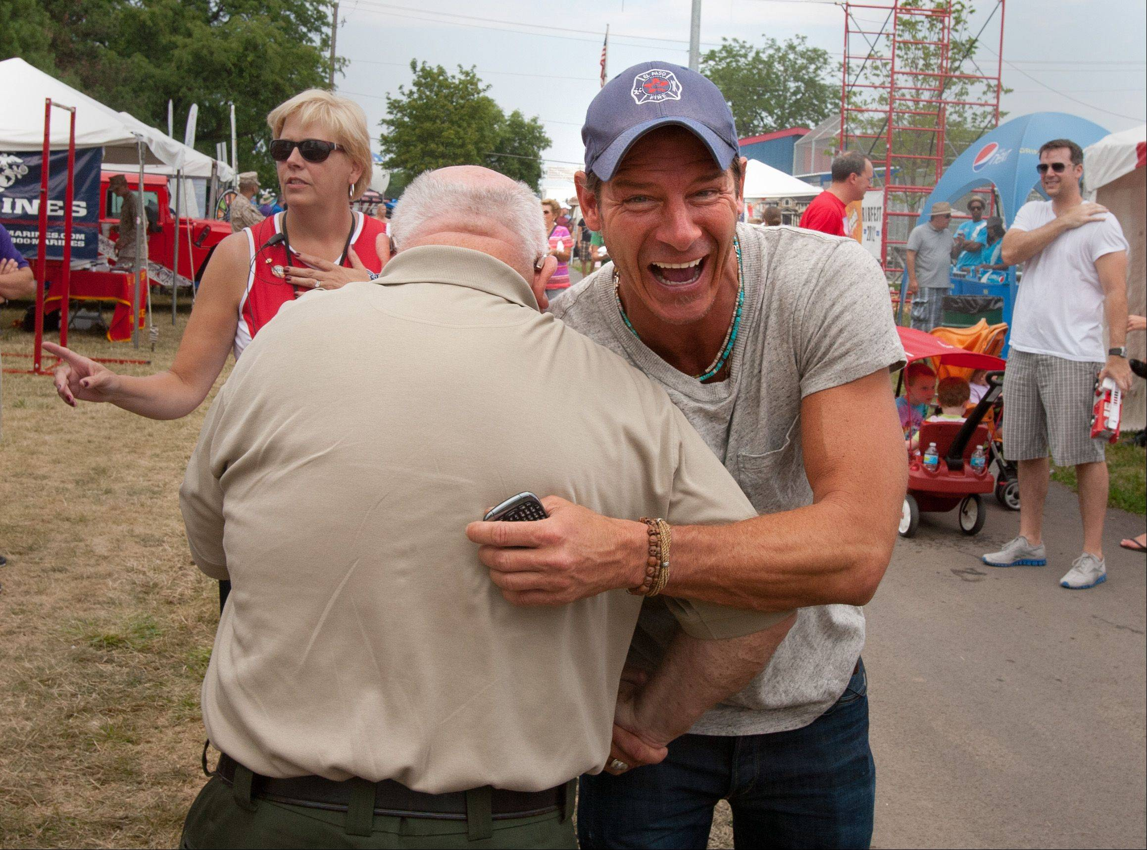 """Extreme Makeover: Home Edition"" star Ty Pennington gets a greeting Saturday from Naperville Mayor George Pradel during the 25th annual Ribfest at Knoch Park. Pennington came to the festival to offer grilling advice and meet fans."