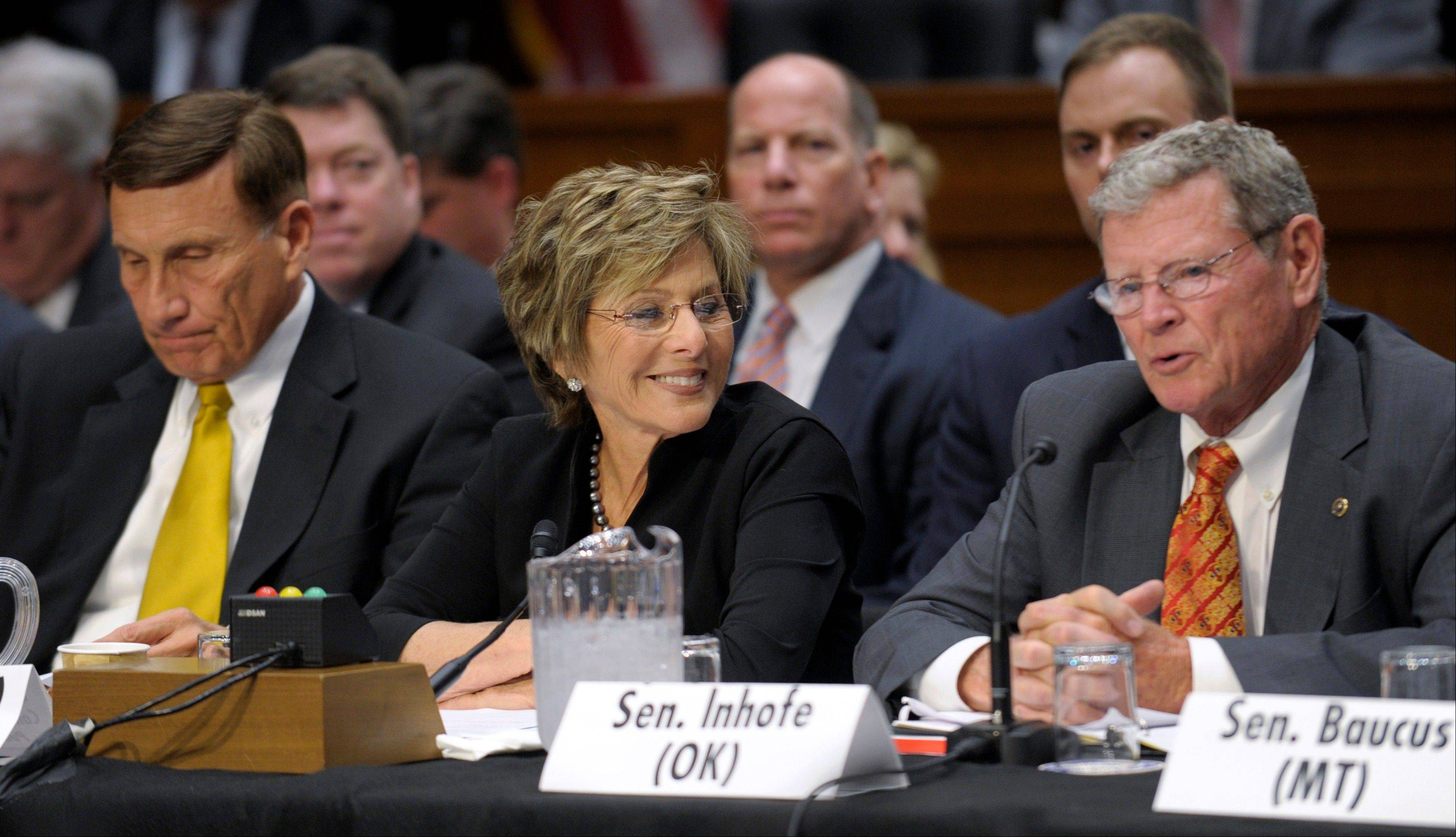 Associated Press/May 8, 2012Sen. Barbara Boxer, D-Calif., center, and Rep. John Mica, R- Fla., left, listen as Sen. James Inhofe, R-Okla., right, speaks during the first meeting of the House and Senate conference on the transportation bill on Capitol Hill in Washington.