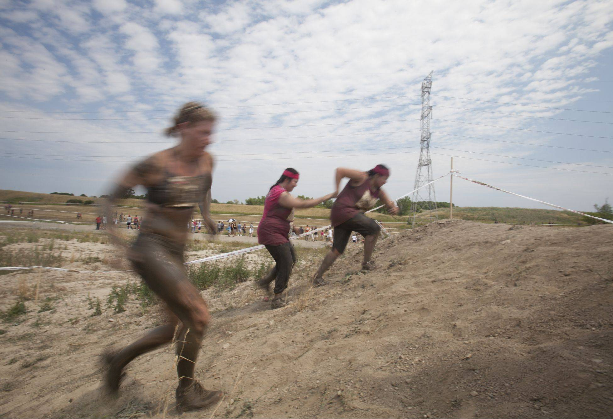 Around 8,000 women came out to Lake County Fair Grounds in Grayslake Saturday to participate in the Dirty Girl Mud Run. A portion of the proceeds goes out to the National Breast Cancer Association.