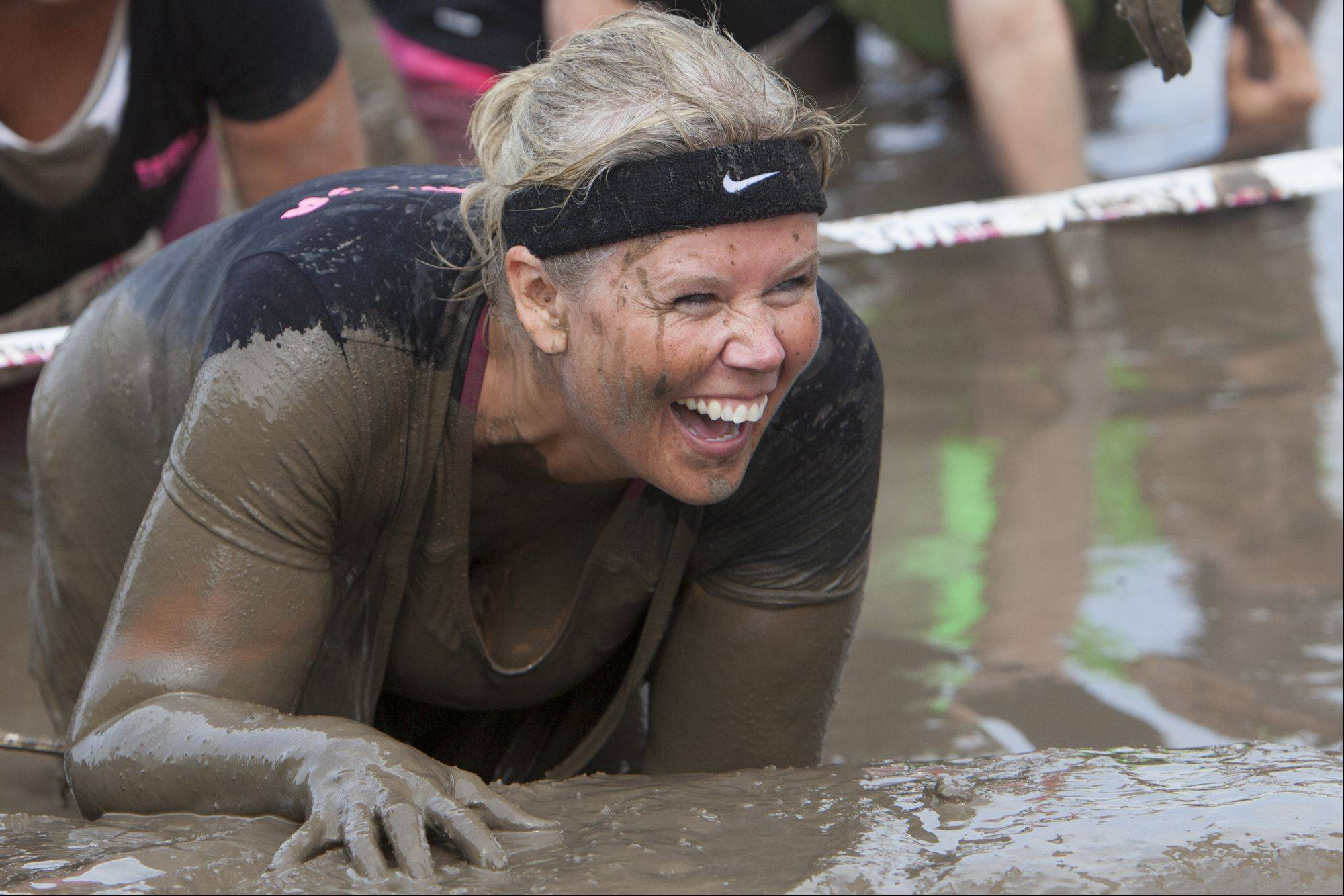 Stacey Anderson of Lindenhurst laughs when she reaches the end of an mud obstacle course during the Dirty Girl Mud Run.