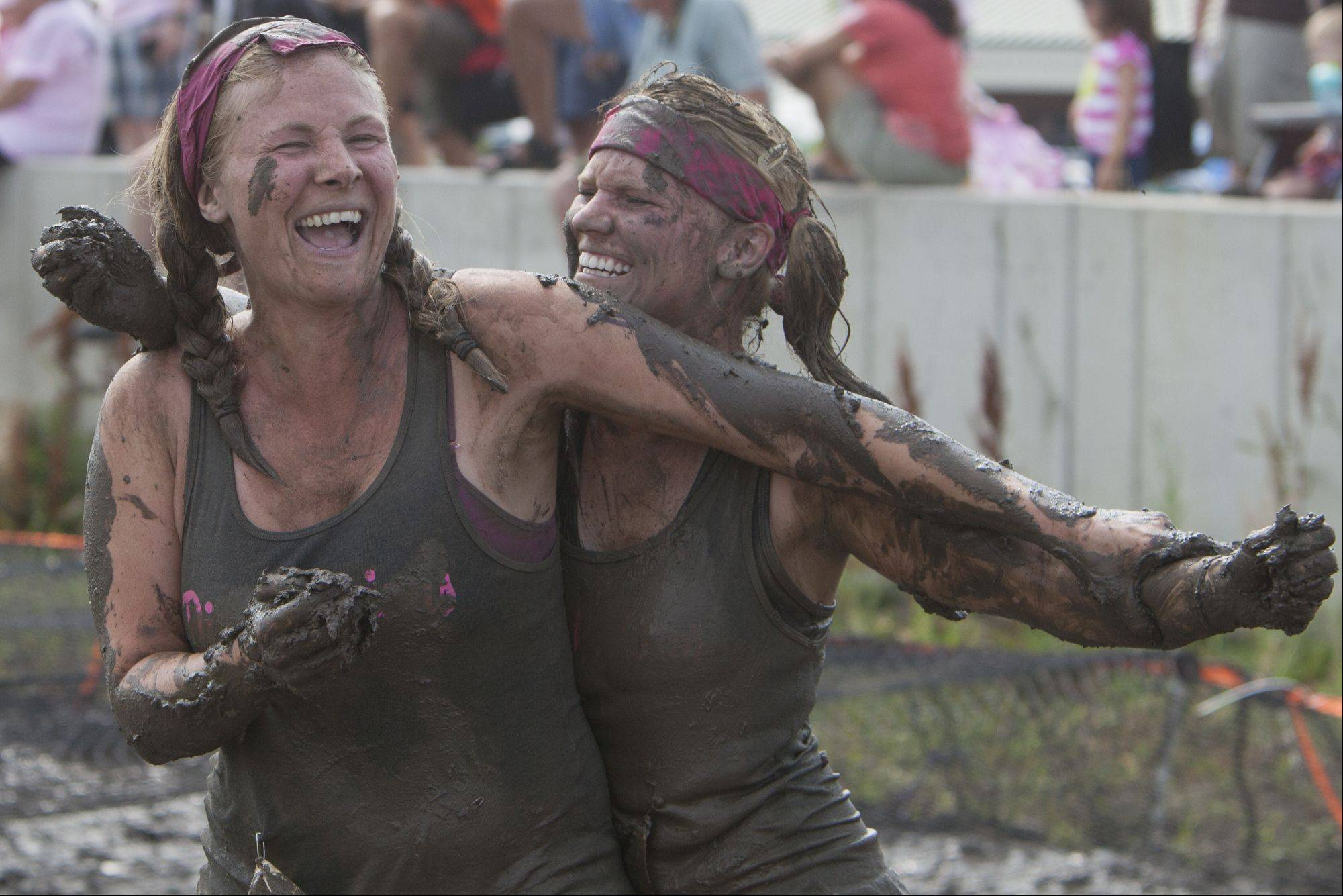 Lauren Schultz of Grayslake and Lindey Skelley of Wauconda wipe mud on each other during the Dirty Girl Mud Run.