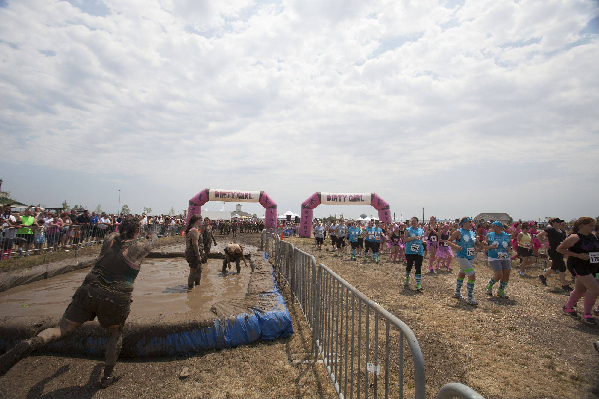 As women finish the Dirty Girl Mud Run others begin their 5K trek, Groups left every 15 minutes from the starting area. Around 8,000 women came out to Lake County Fair Grounds in Grayslake Saturday to participate in the fundraiser for the National Breast Cancer Association.
