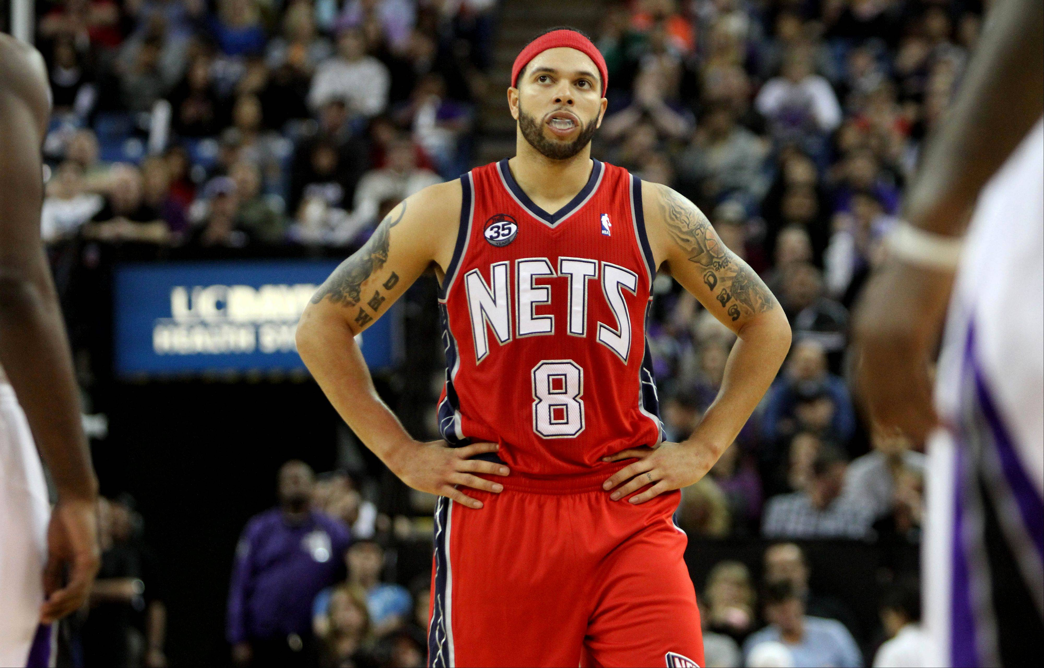 New Jersey Nets guard Deron Williams is seen during the second half of an NBA basketball game against the Sacramento Kings in Sacramento, Calif., Saturday, March 31, 2012. The Nets won 111-99.