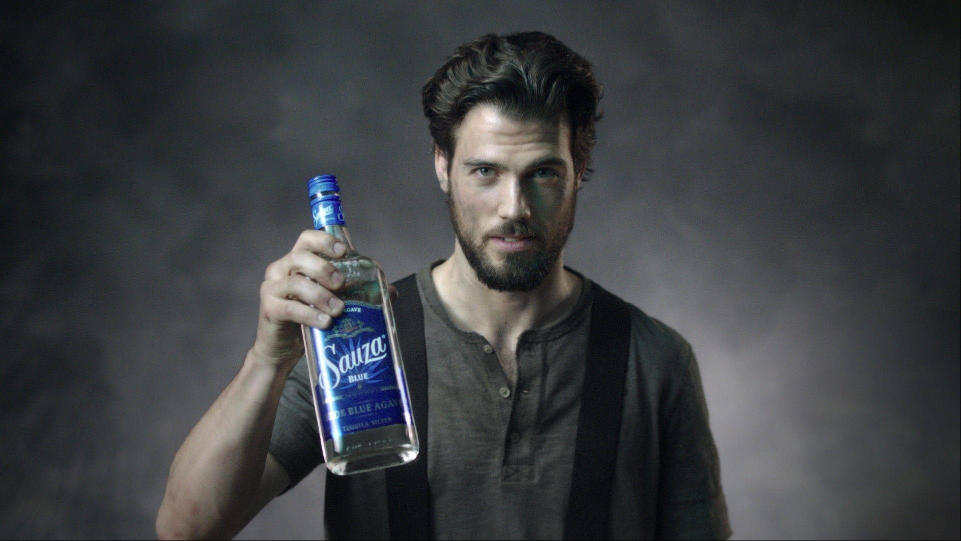 "This image from video released by Sauza shows a fireman holding a bottle of Sauza Tequila for a video directed by Matt Lenski for the ""Make it with a Fireman"" campaign. The ad, launched in April, reflects a shift in spirits marketing as some producers look beyond traditional male-oriented campaigns."