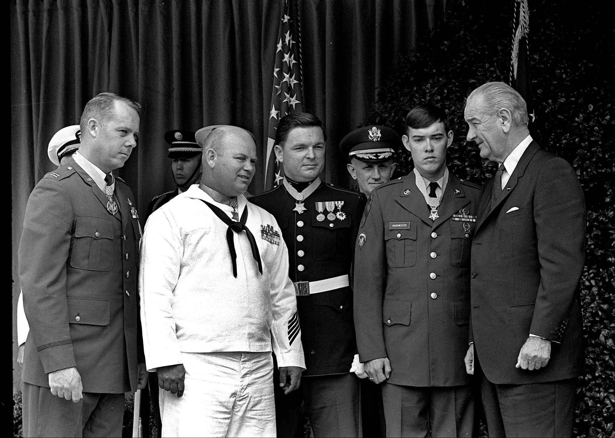 In this May 14, 1968, photo, President Lyndon Johnson, right, poses at the White House with four winners of the nation's highest award, the Medal of Honor. Decorated for valor in Vietnam, they are, from left: Air Force Capt. Gerald O. Young, Navy Bosn's Mate James E. Williams, Marine Sgt. Richard A. Pittman and Army Spc. 5 Charles C. Hagmeister