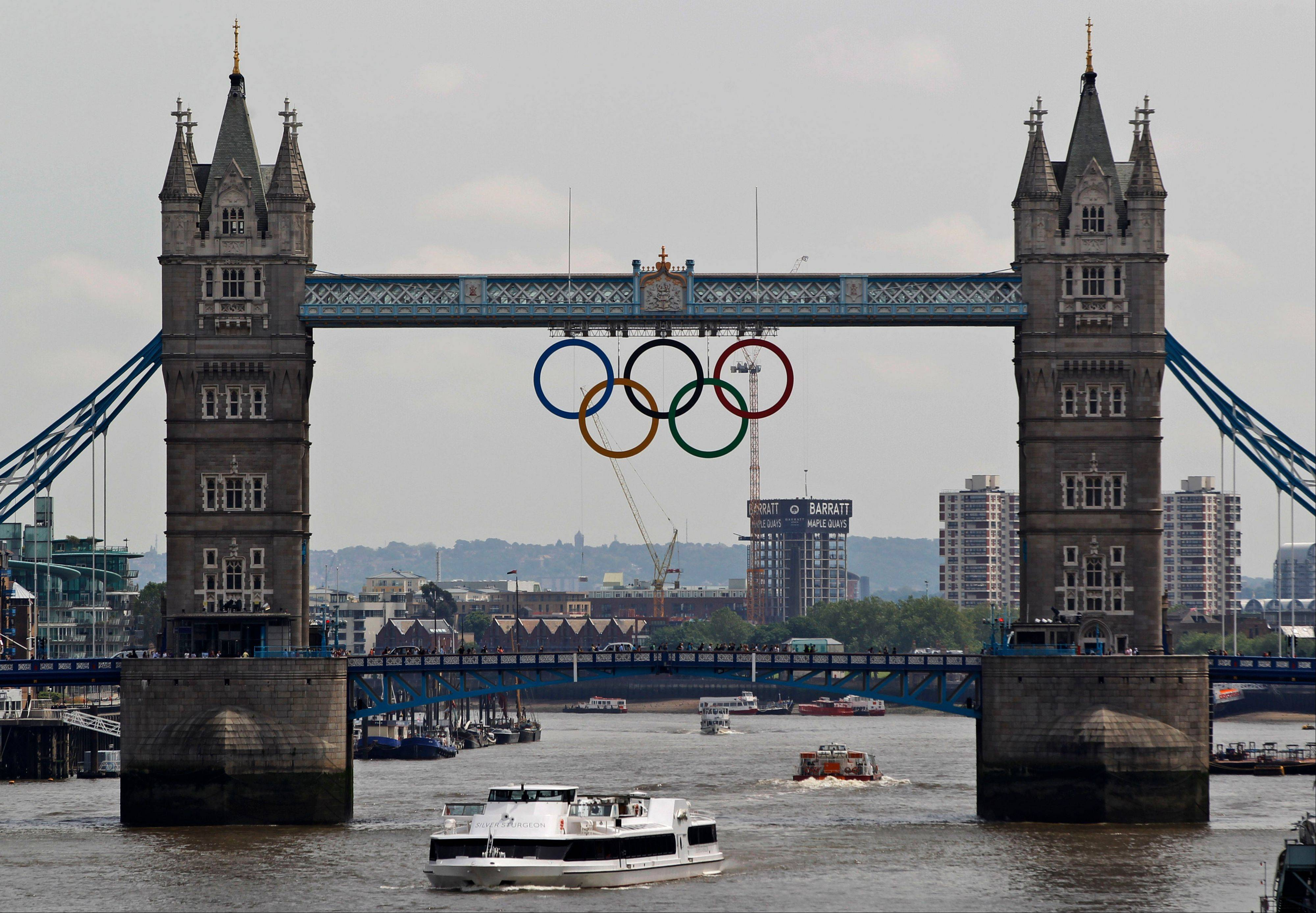 The Olympic rings sit atop the iconic Tower Bridge over the Thames in London. The giant rings will remain in position for the duration of the London 2012 Games.