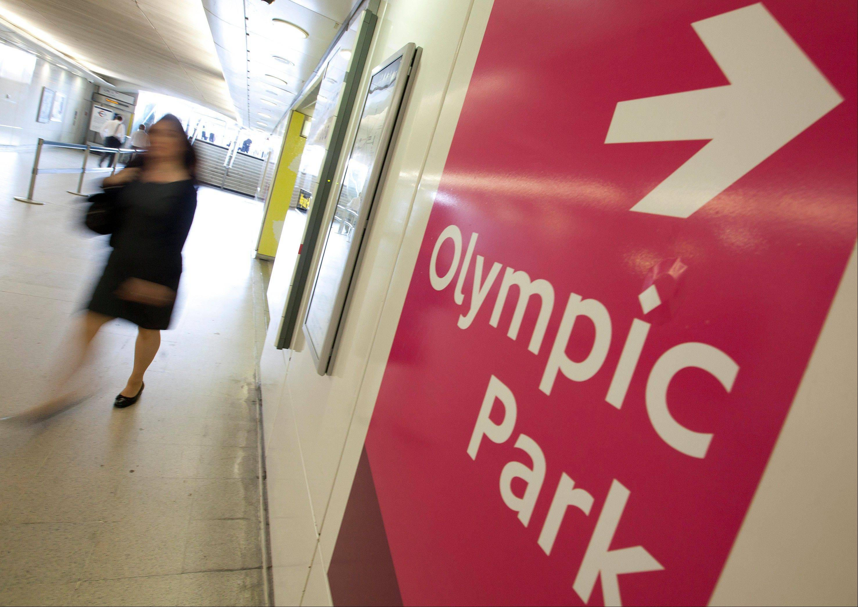 Signs pointing to the Olympic Park are seen at Stratford underground in station.