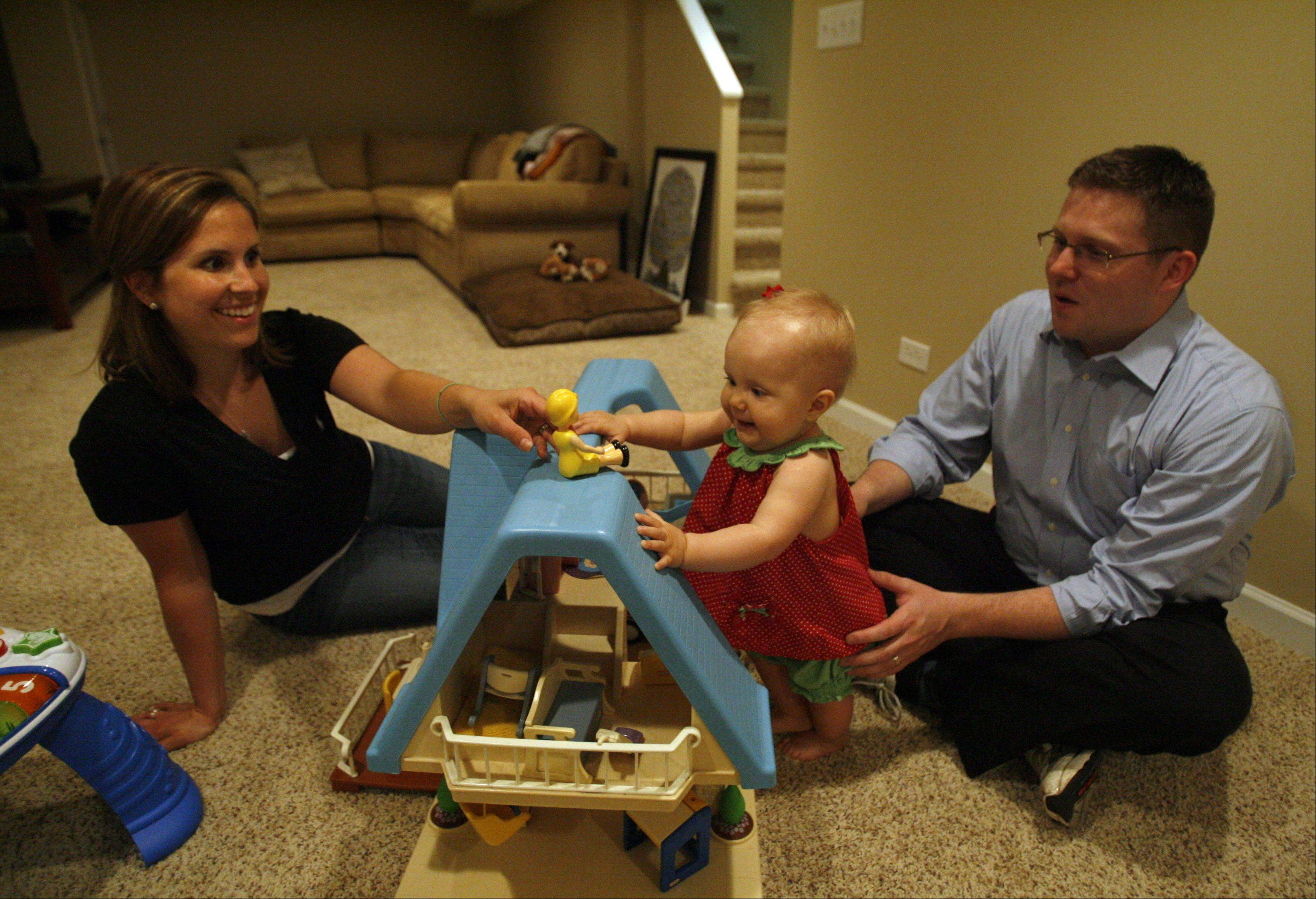 Contest winners Matt and Anne Edwards, with 10-month-old daughter Katherine, won a grand prize of a $25,000 basement makeover from Matrix Basement Finishing System.