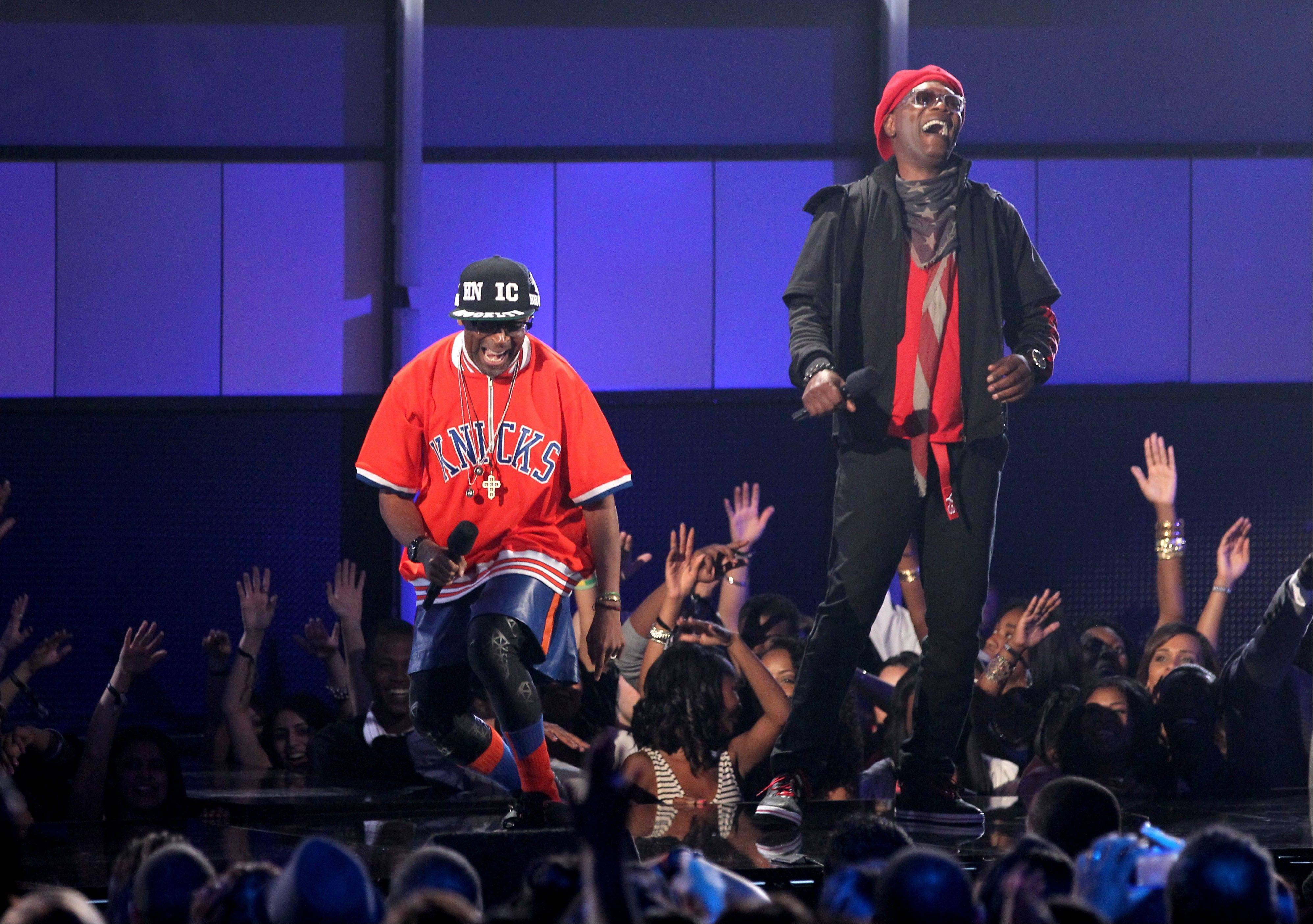Host Samuel L. Jackson, right, and Spike Lee appear on stage at the BET Awards on Sunday in Los Angeles.