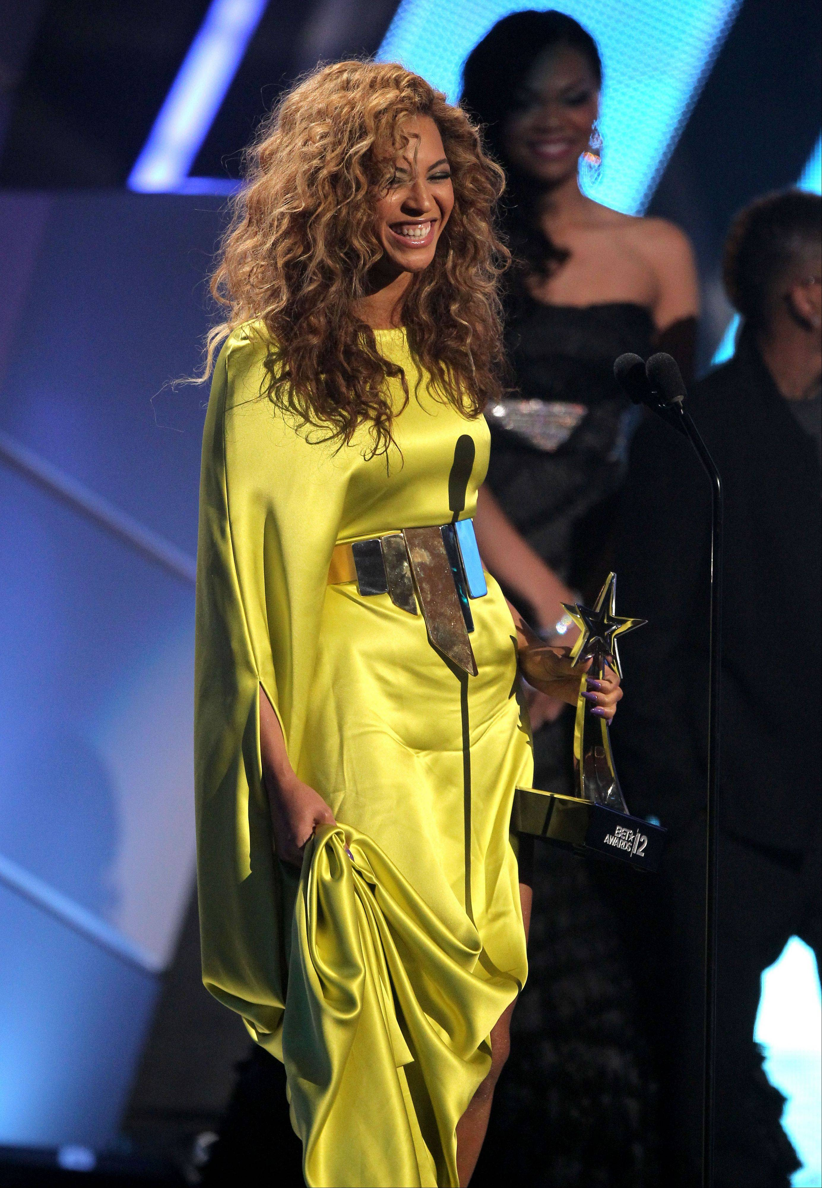 Beyonce accepts the award for best female R& B at the BET Awards on Sunday in Los Angeles.