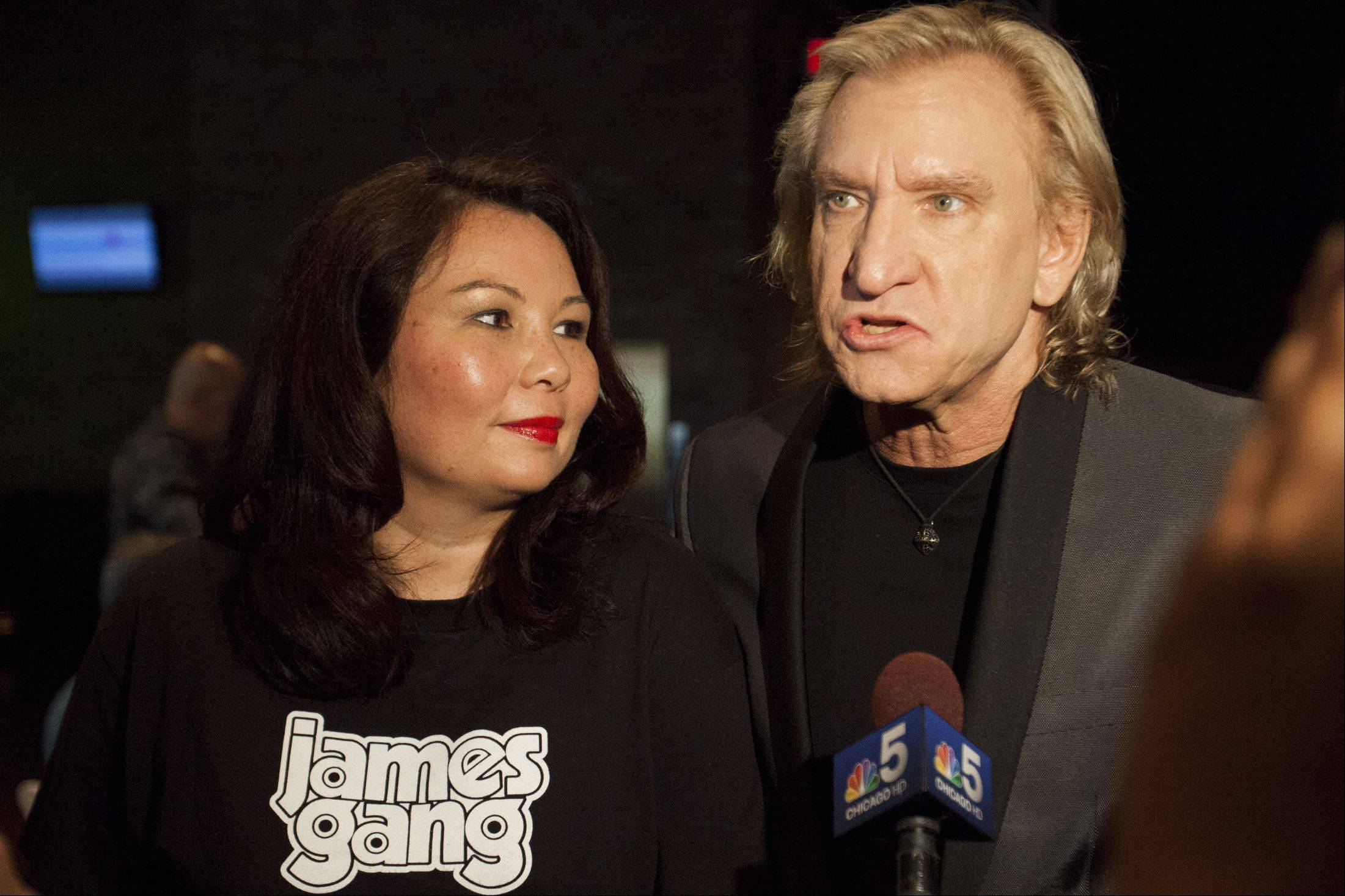 Rocker Joe Walsh talks about his support for Tammy Duckworth for the 8th Congressional District of Illinois during an appearance for her campaign at John Barleycorn in Schaumburg Sunday night.